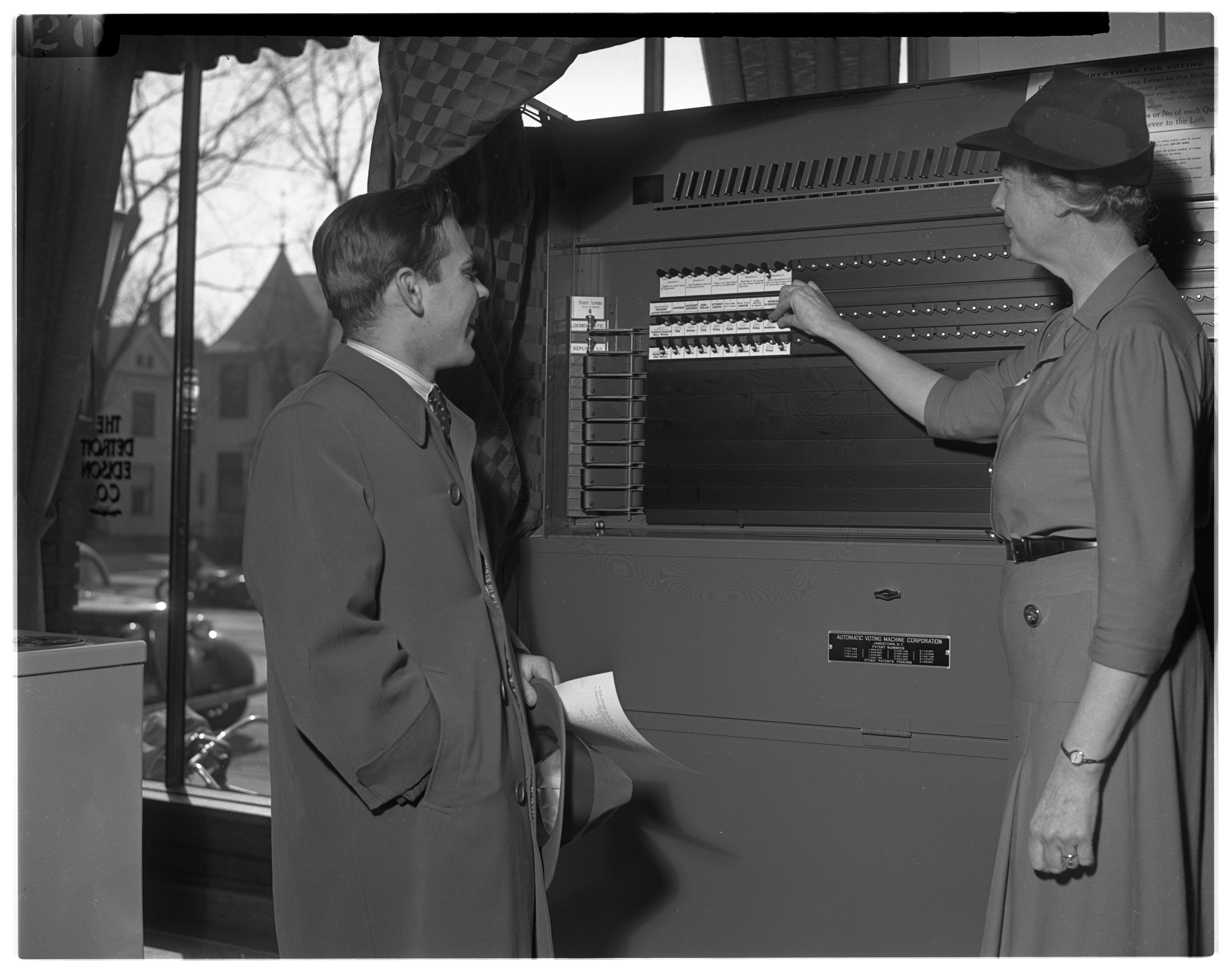 League Of Women Voters Member, DeEtta Forsythe, Demonstrates Voting Machine Operation, March 1942 image