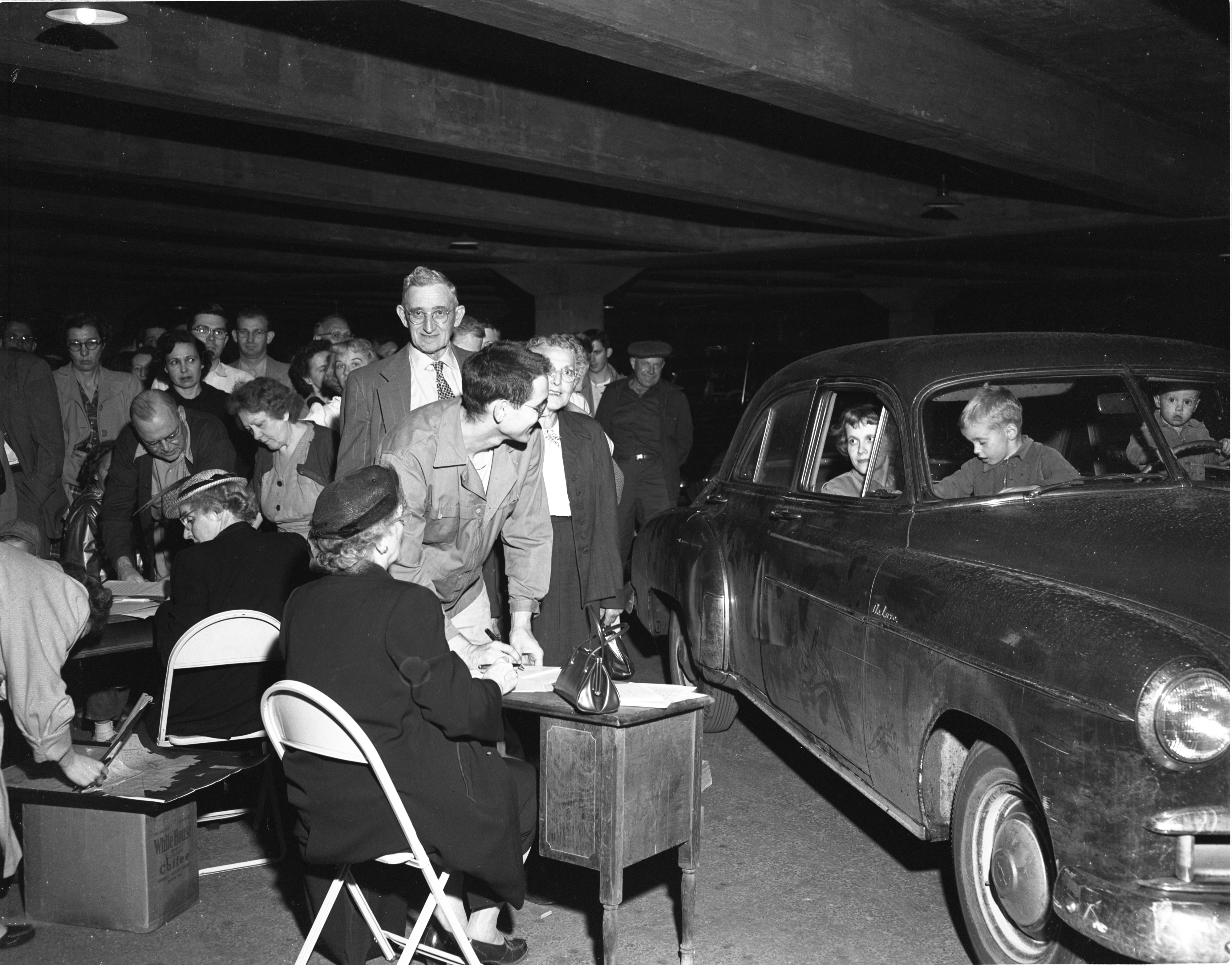 "Darwin L. Wood Registers To Vote With Carport ""Curb Service"", June 1952 image"