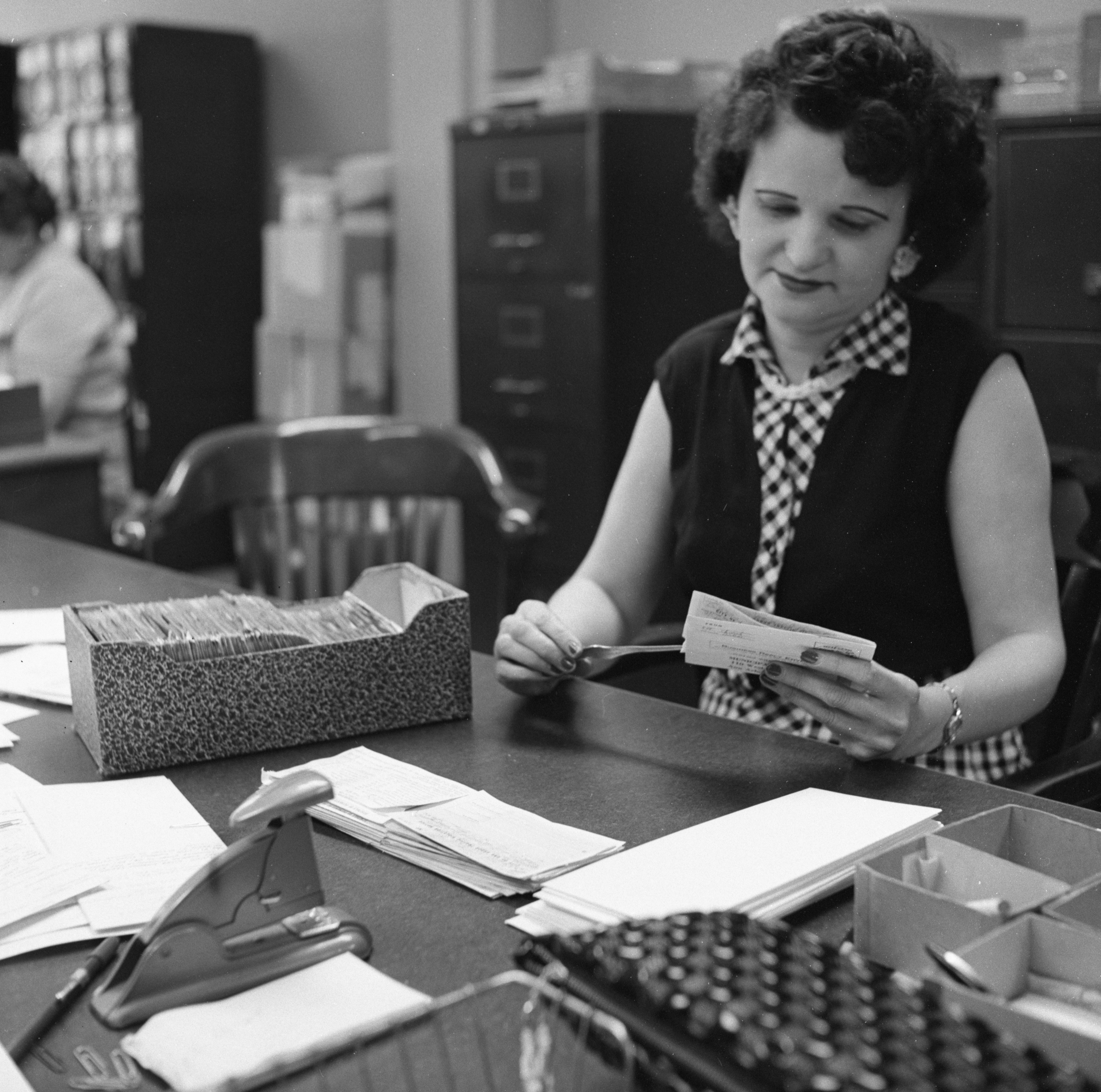 Nancy M. Juniewicz Opens Mailed Parking Tickets In Municipal Court Office, May 1958 image