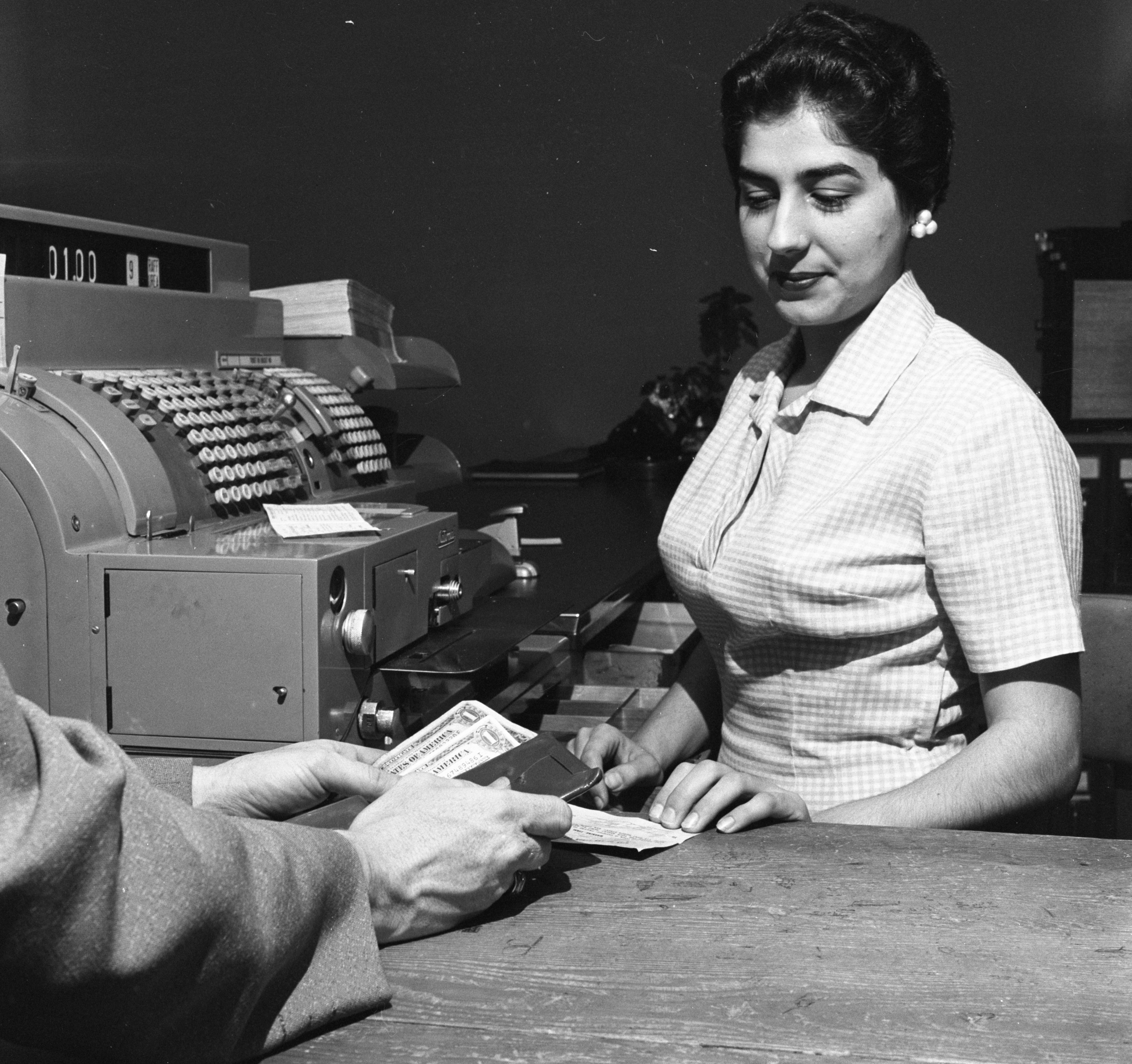 Sophie Carras, Municipal Court Office Cashier, Accepts Parking Violation Payment - May 1958 image