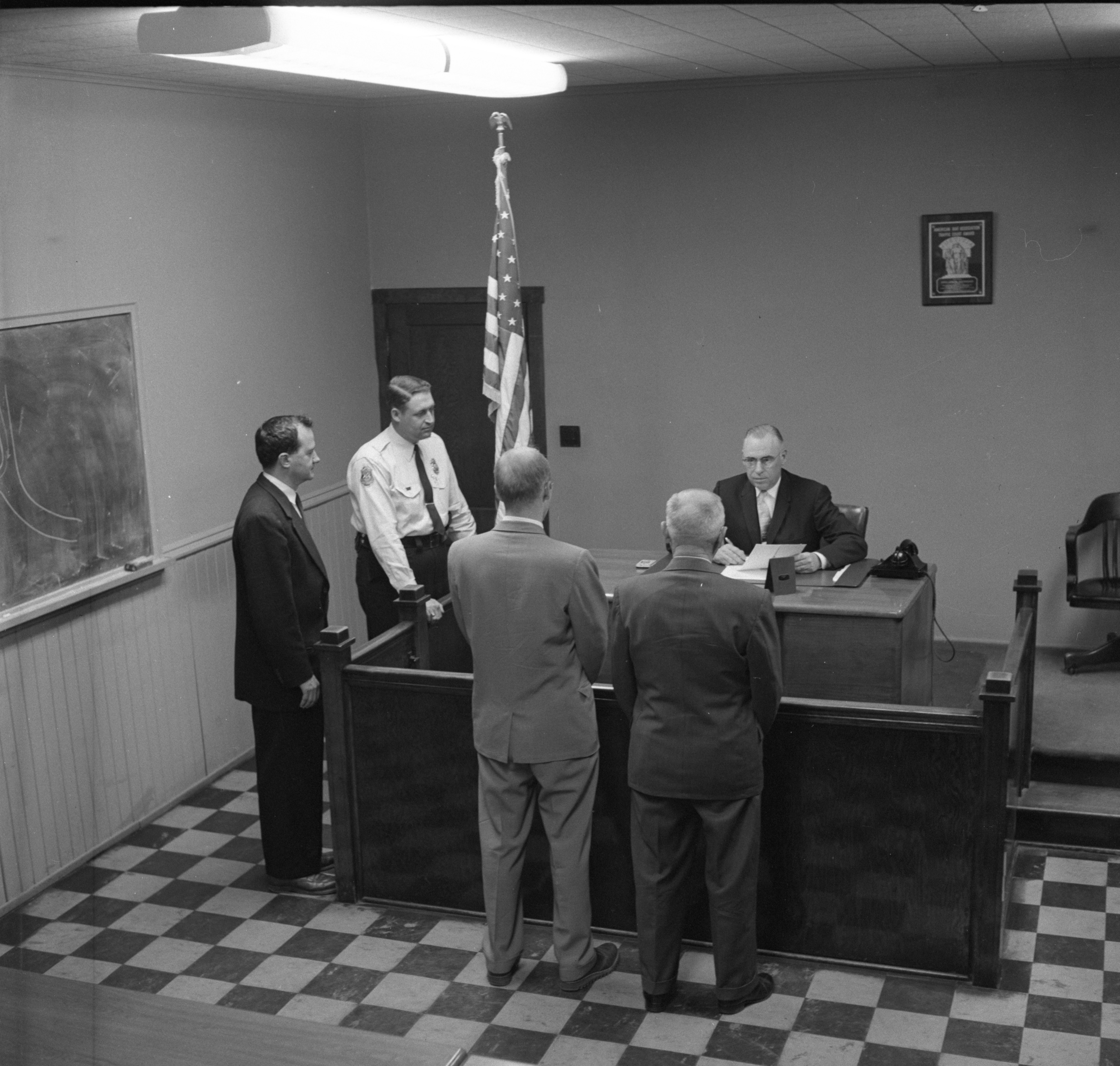 Municipal Court Judge Francis L. O'Brien Hears Evidence In A Case - May 1958 image