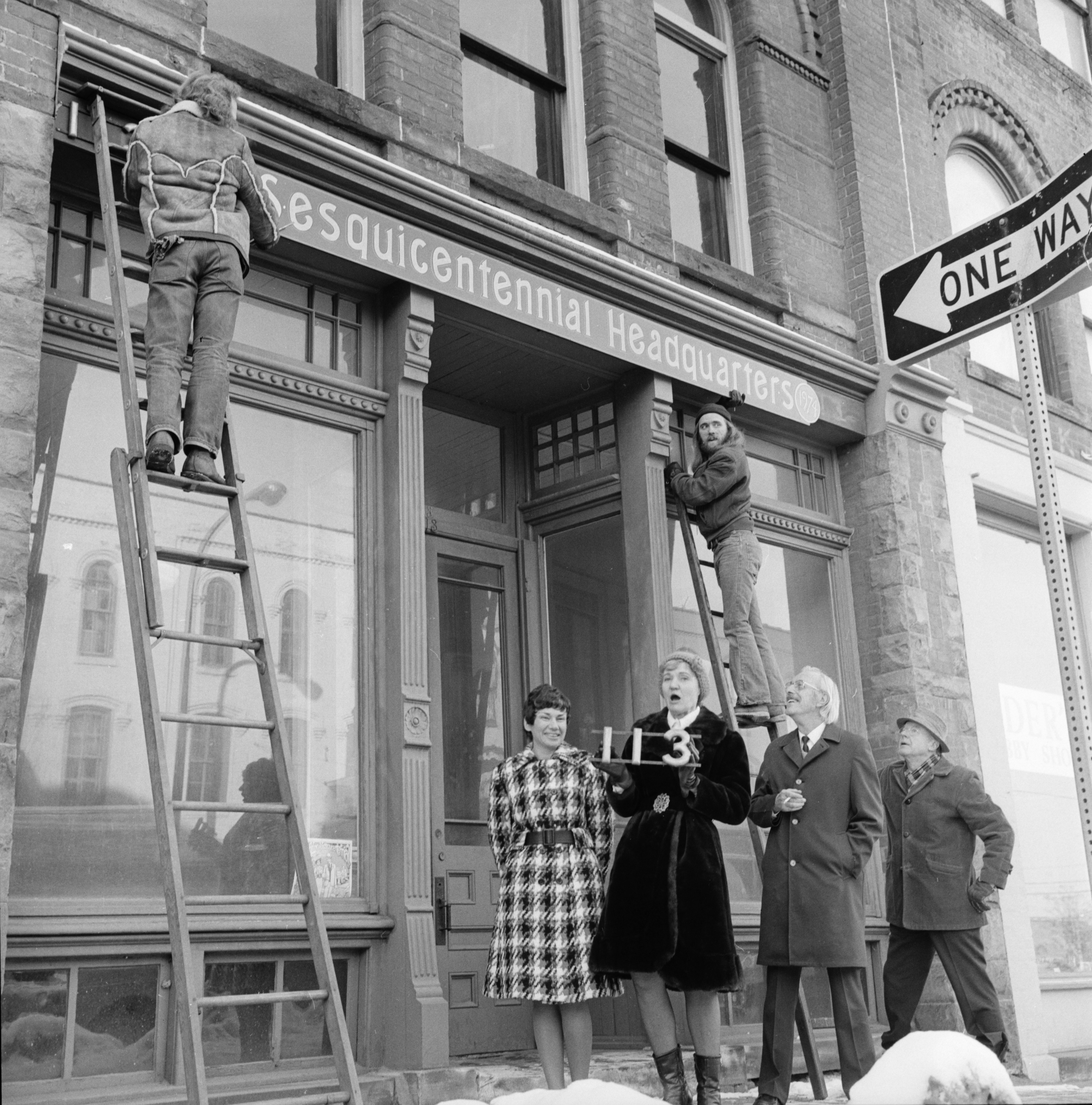 Sesquicentennial Headquarters Sign Hanging at Haarer-Walker Building, 113 W. Liberty, January 1974 image