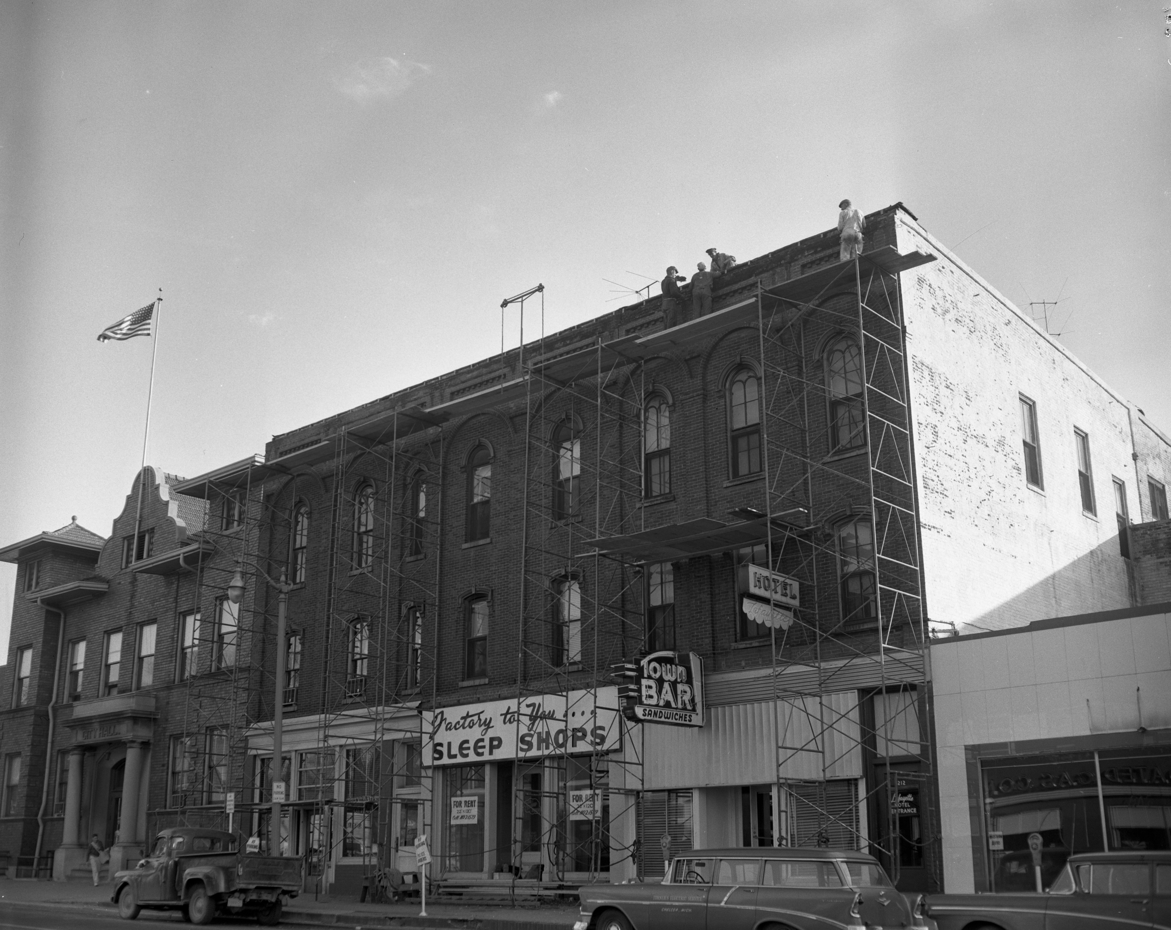 Faulty cornice removed from city building, November 1958 image