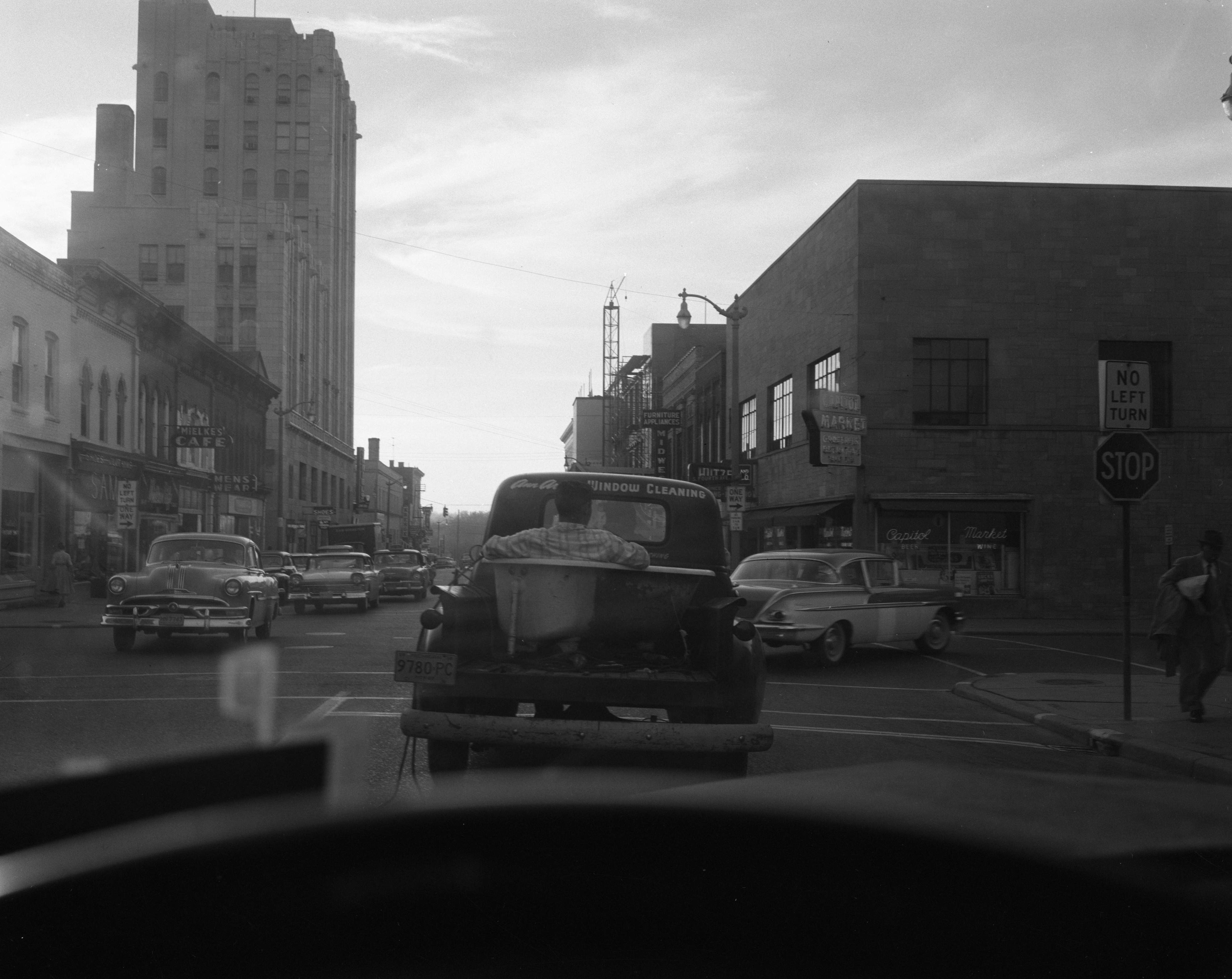 window cleaning ann arbor man rides in back of truck bathtub october 1958 ann arbor window cleaning district library