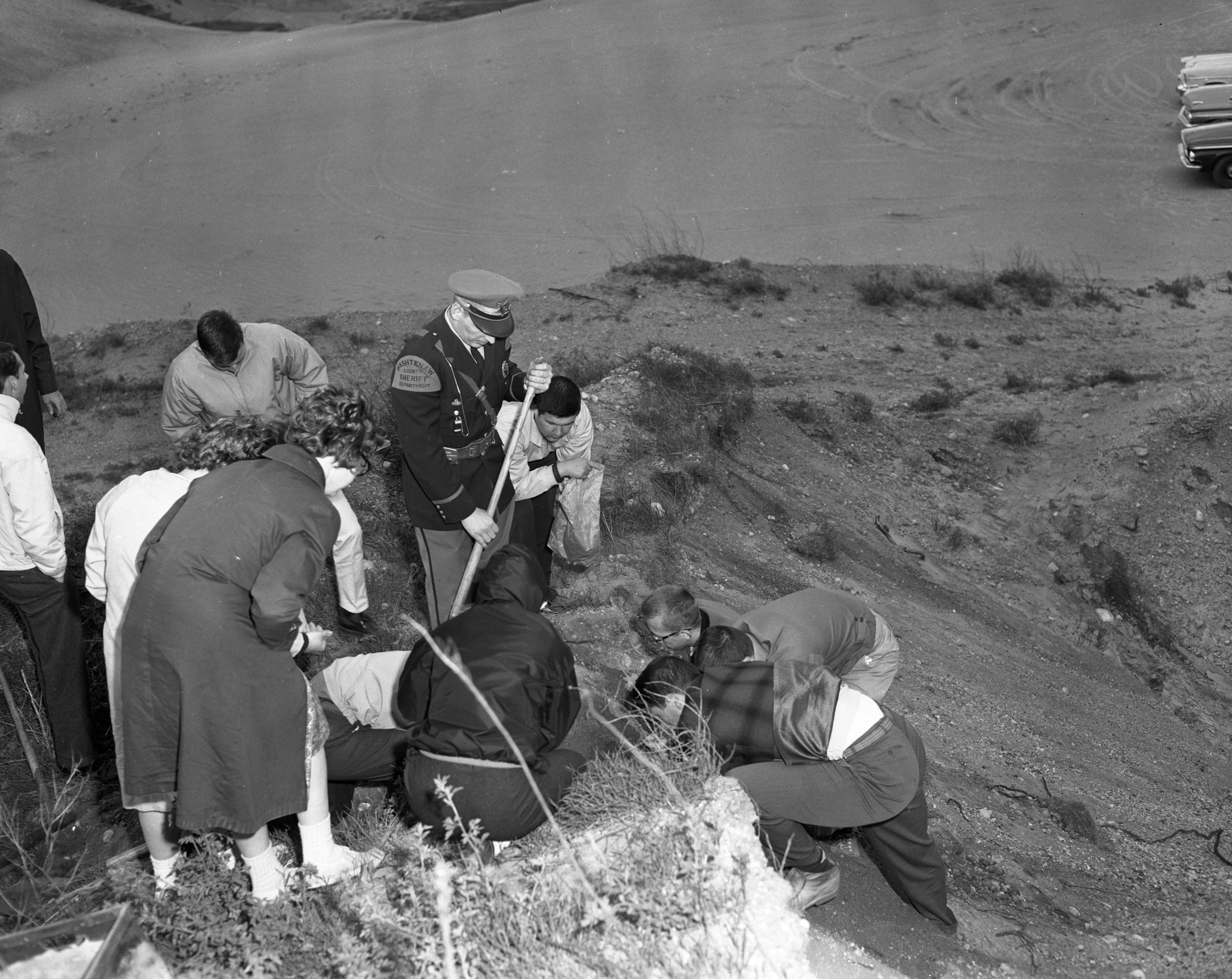 EMU Students Examine Skeleton They Found at Killins Gravel Pit, May 1963 image