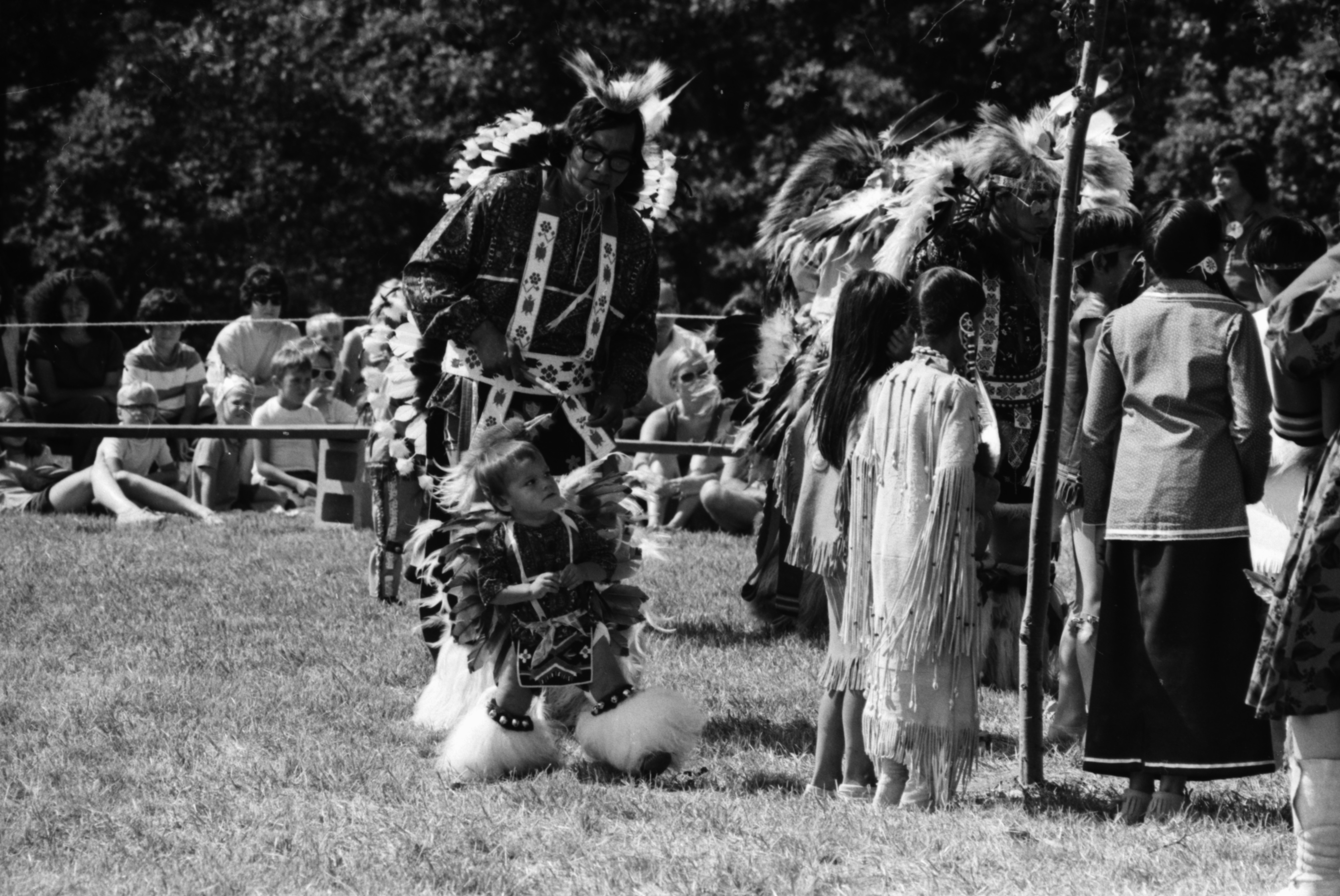 Stanley Morseau watches his son, Stanley Jr. at the annual Powwow sponsored by American Indians Unlimited (AIU), Knights of Columbus Park, August 1972 image