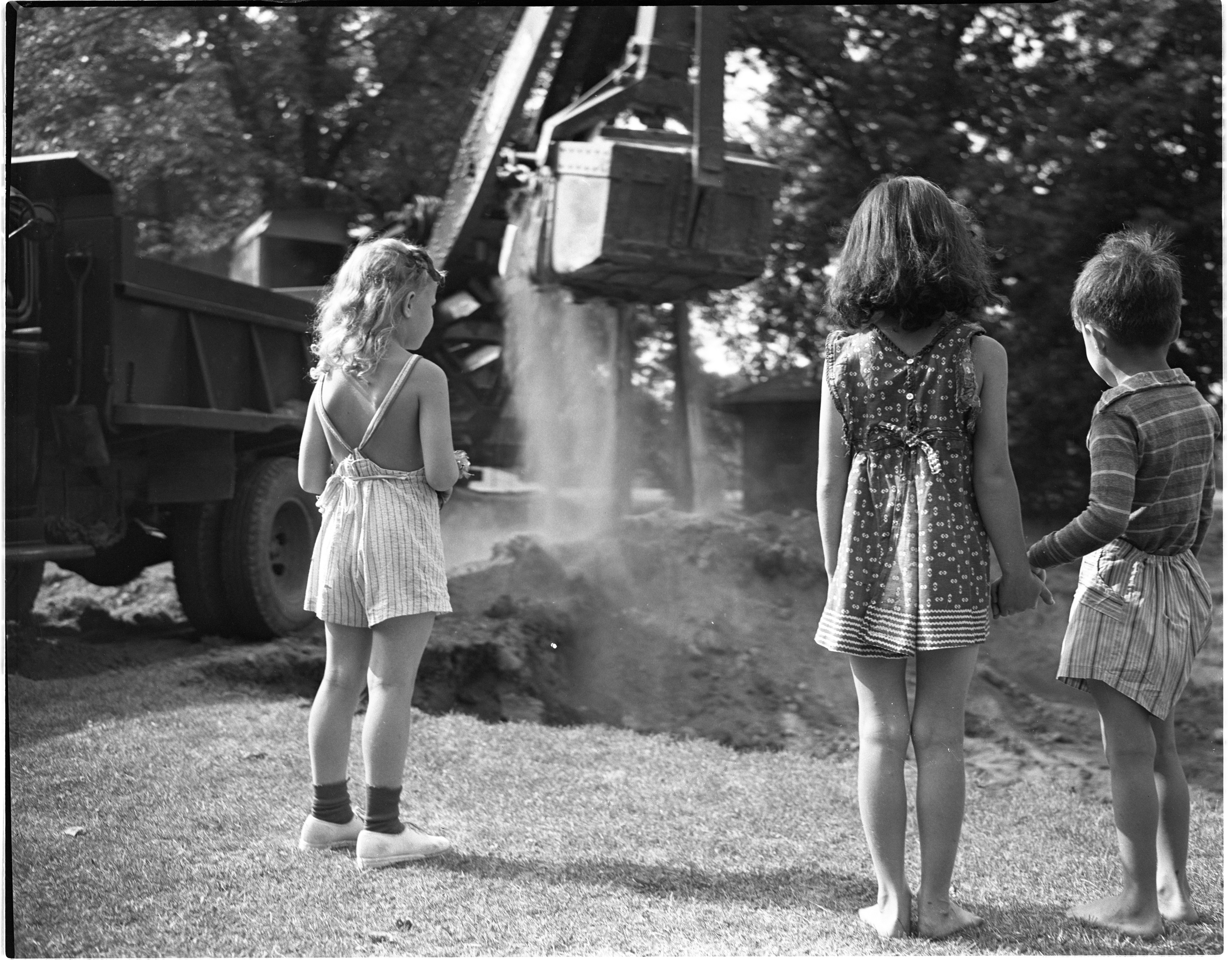 Neighborhood Children Watch The Construction Of The Burns Park Wading Pool, July 1944 image