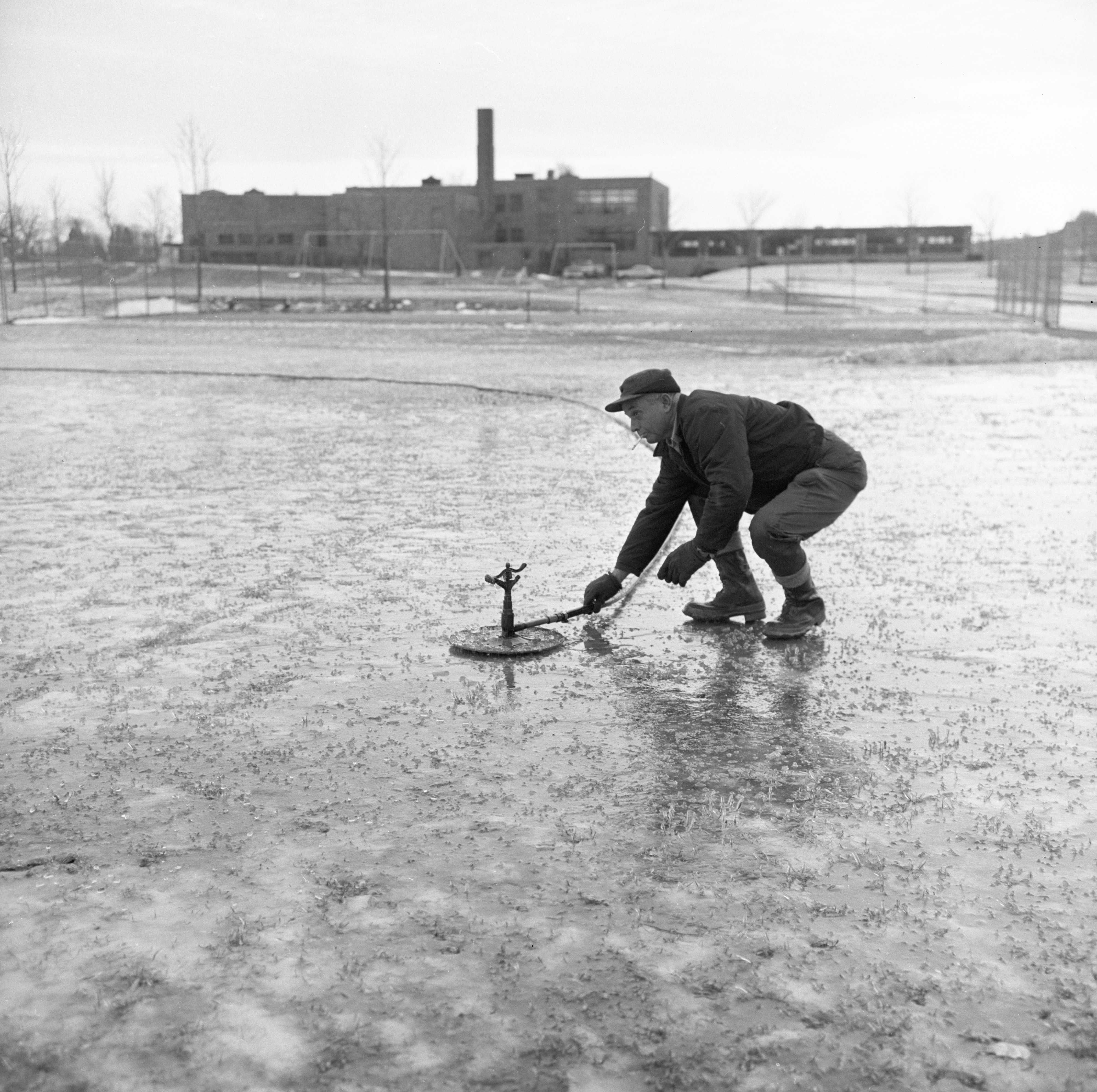Stanley Ehnis Sets Up A Sprinkler On The Northside School Ice Rink, December 1965 image