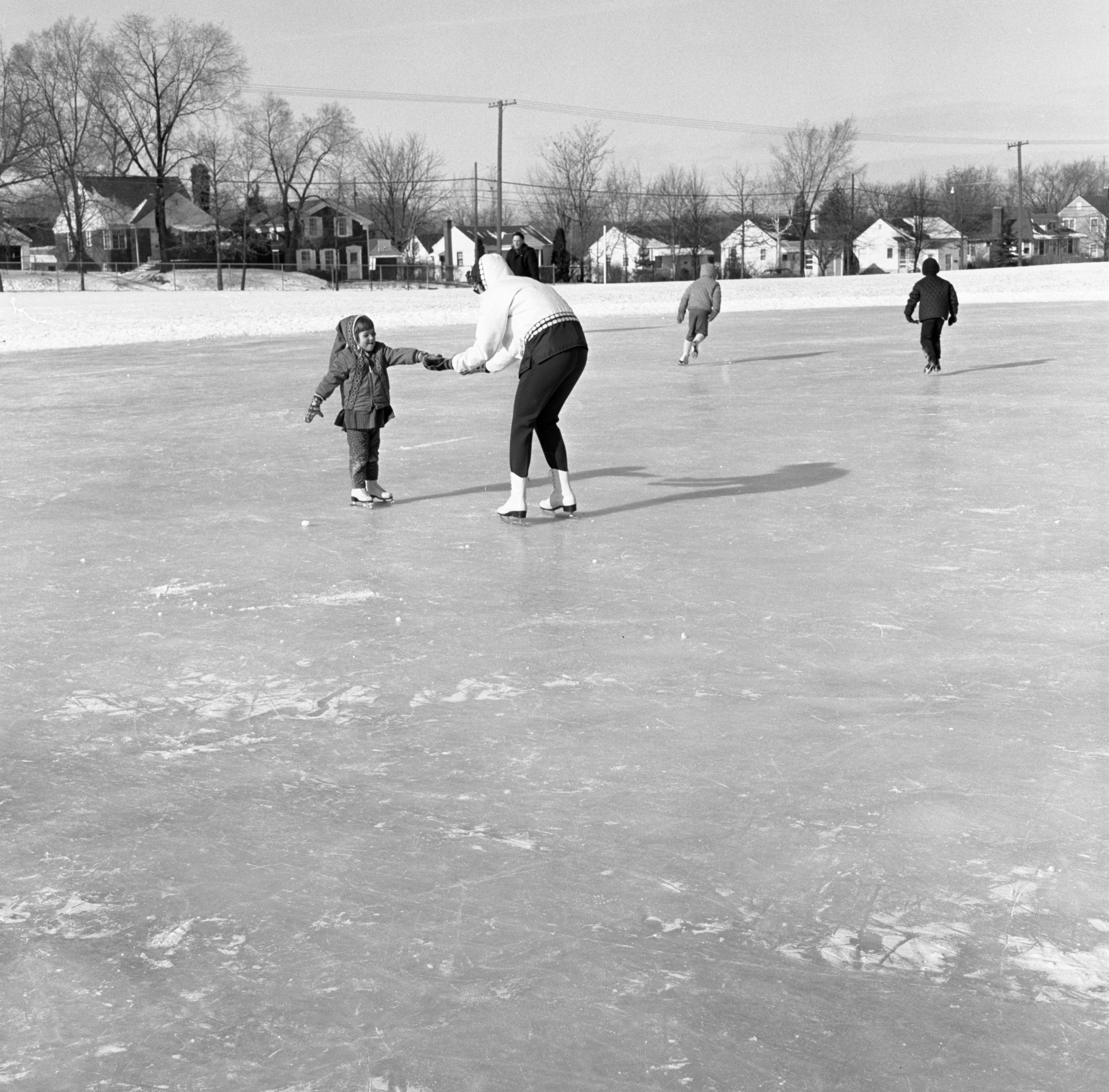 A Mother Teaches Her Daughter To Ice Skate At Northside Park, January 1966 image