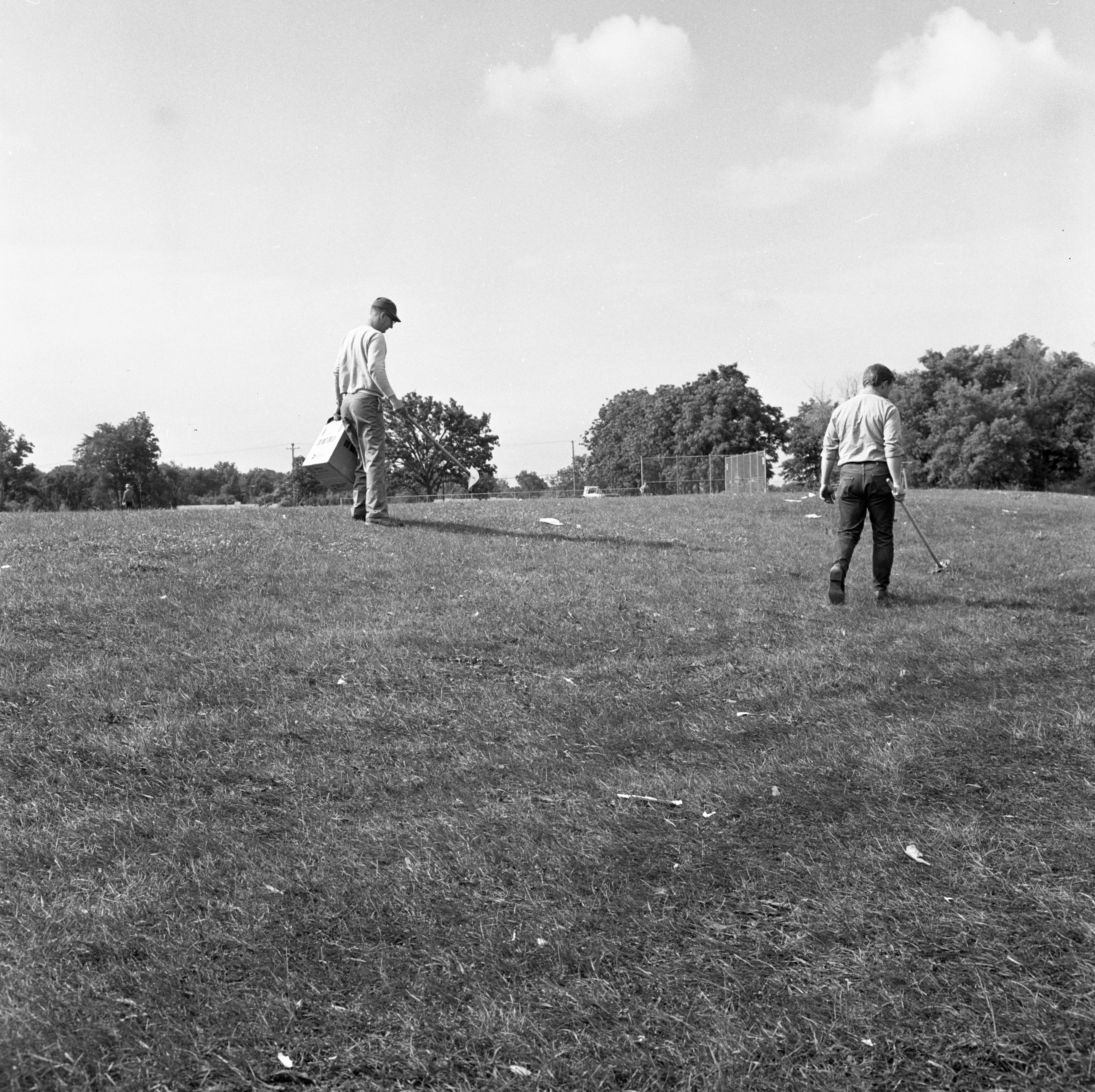 City Workers Clean Up Buhr Park The Morning After Fireworks Show - July 5, 1967 image