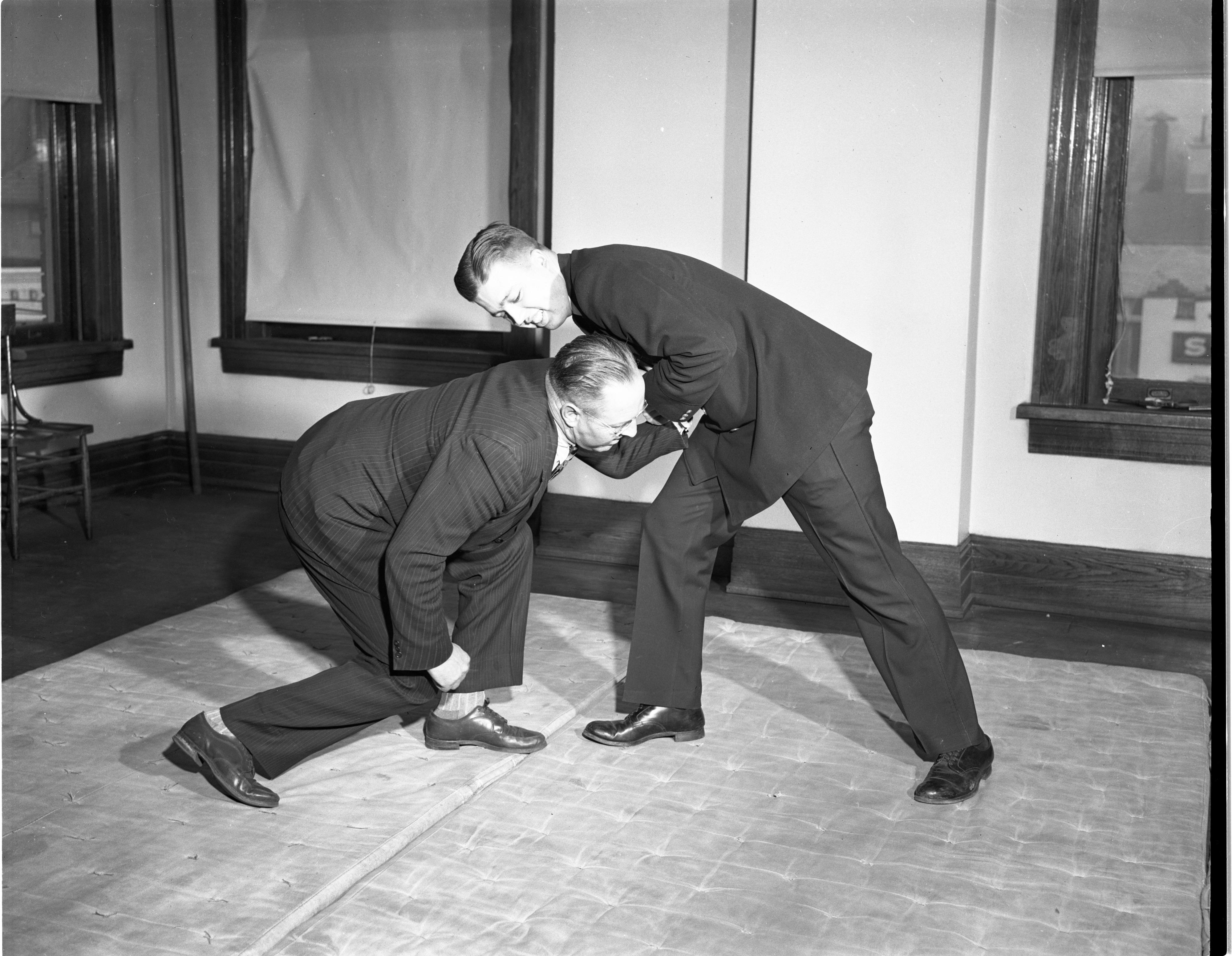 Ann Arbor Police Officer William Marz & Patrolman Harold Olson Practice A Defensive Pass in Judo, March 1947 image