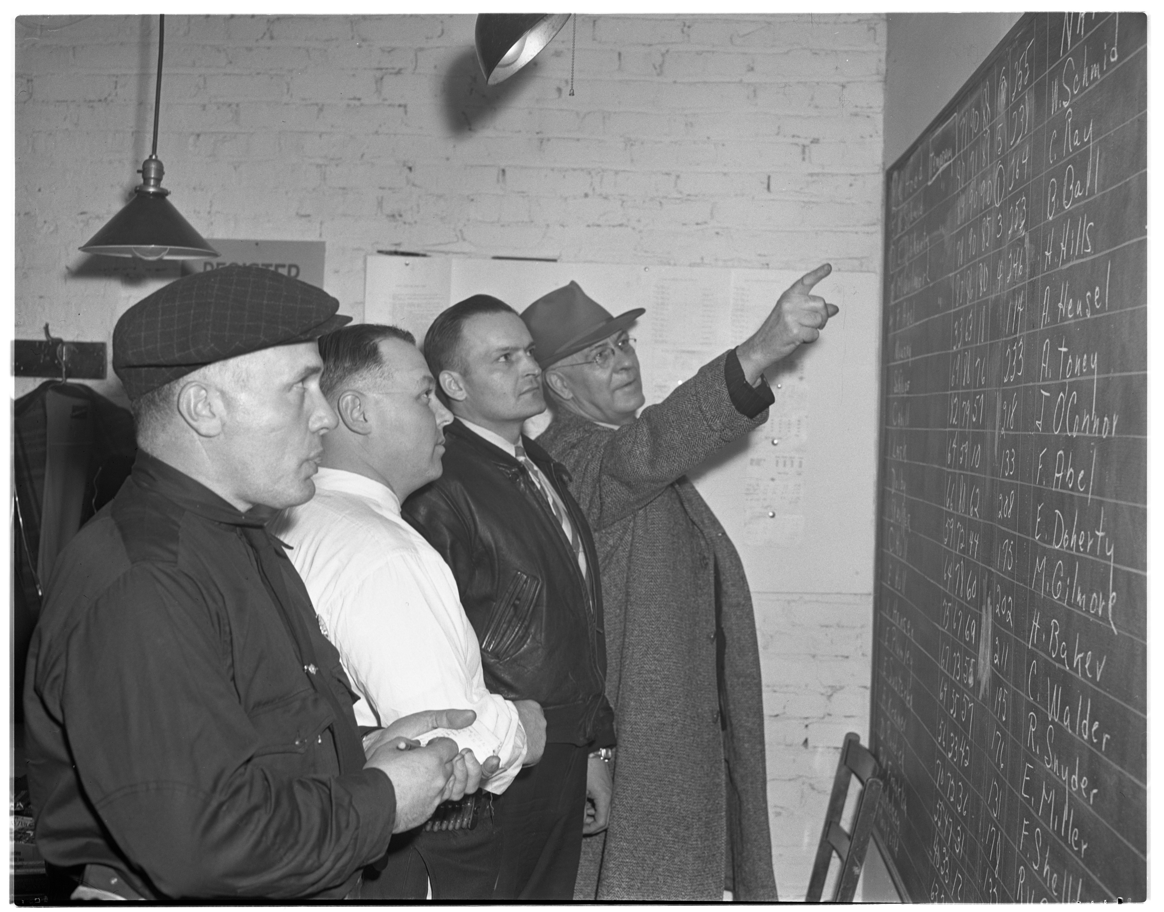 Sharpshooters Review Scores From A Match At The Ann Arbor Police Department's Indoor Range, April 1941 image