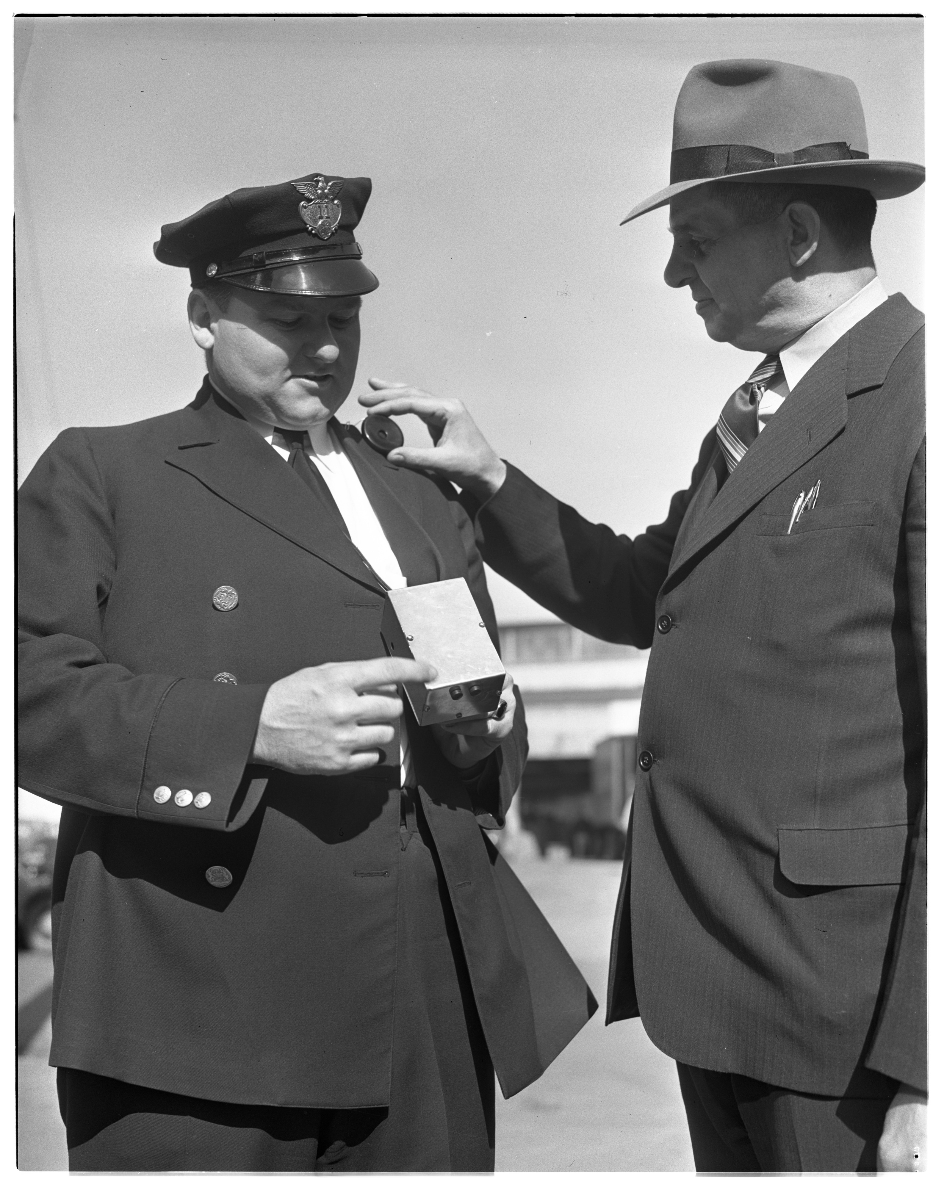 Ann Arbor Police Department Officer Rolland J. Gainsley and Chief of Police Norman Cook with Portable Radio image