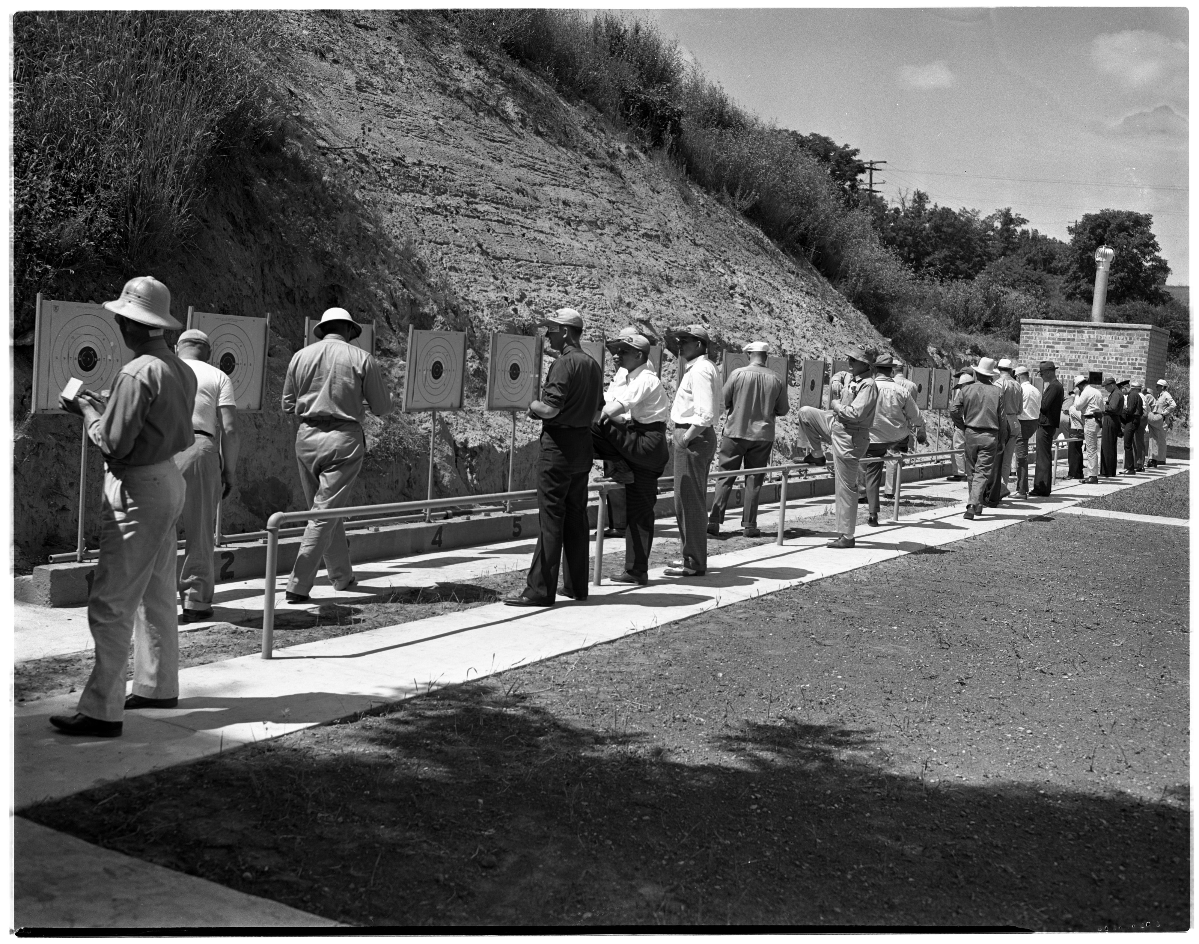 Targets Are Examined At The Ann Arbor Police Department's Invitational Pistol Match, July 1941 image