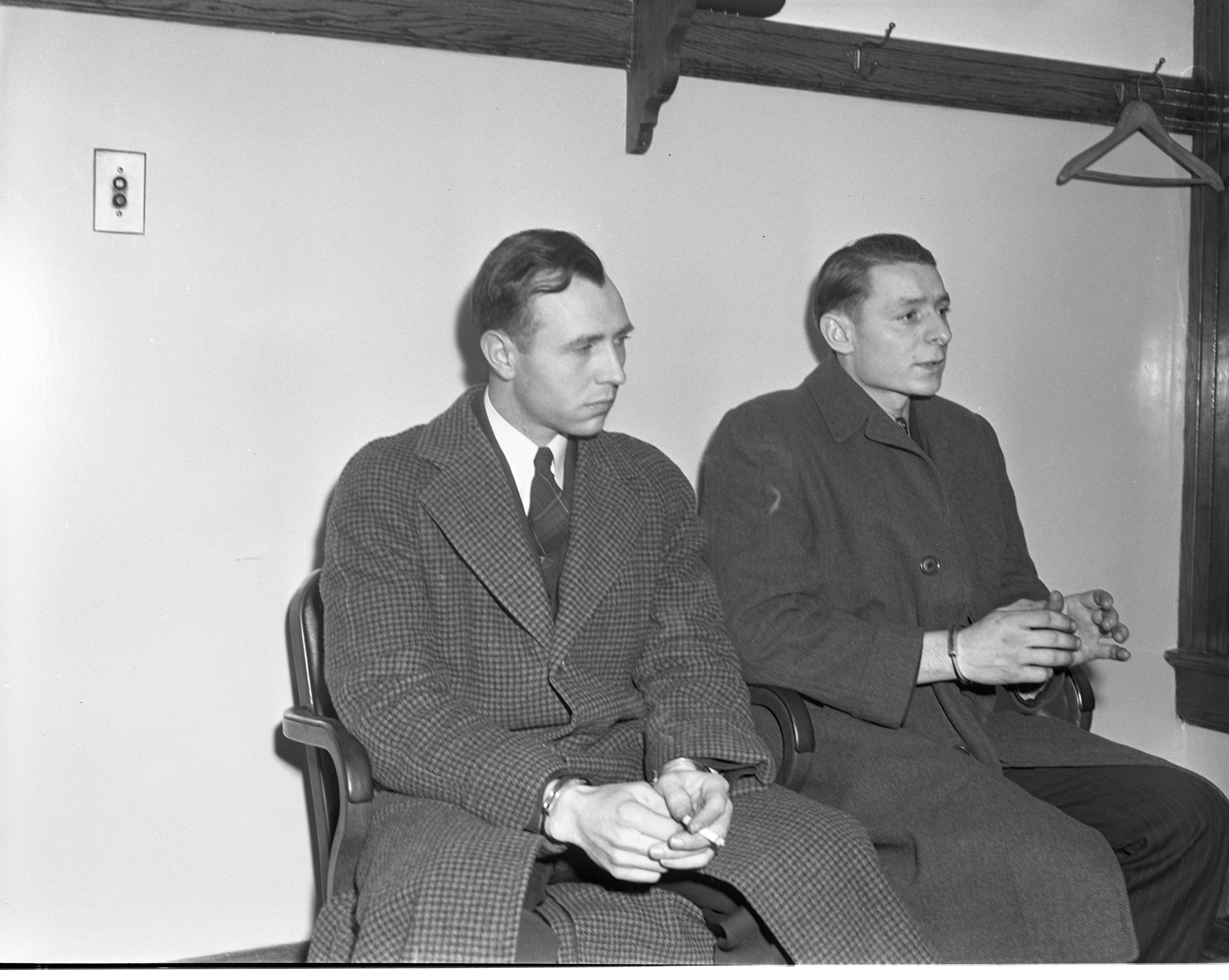 Ambrose DeHaven & Raymond Nowicki Sit Handcuffed In The Ann Arbor Police Station, January 1941 image