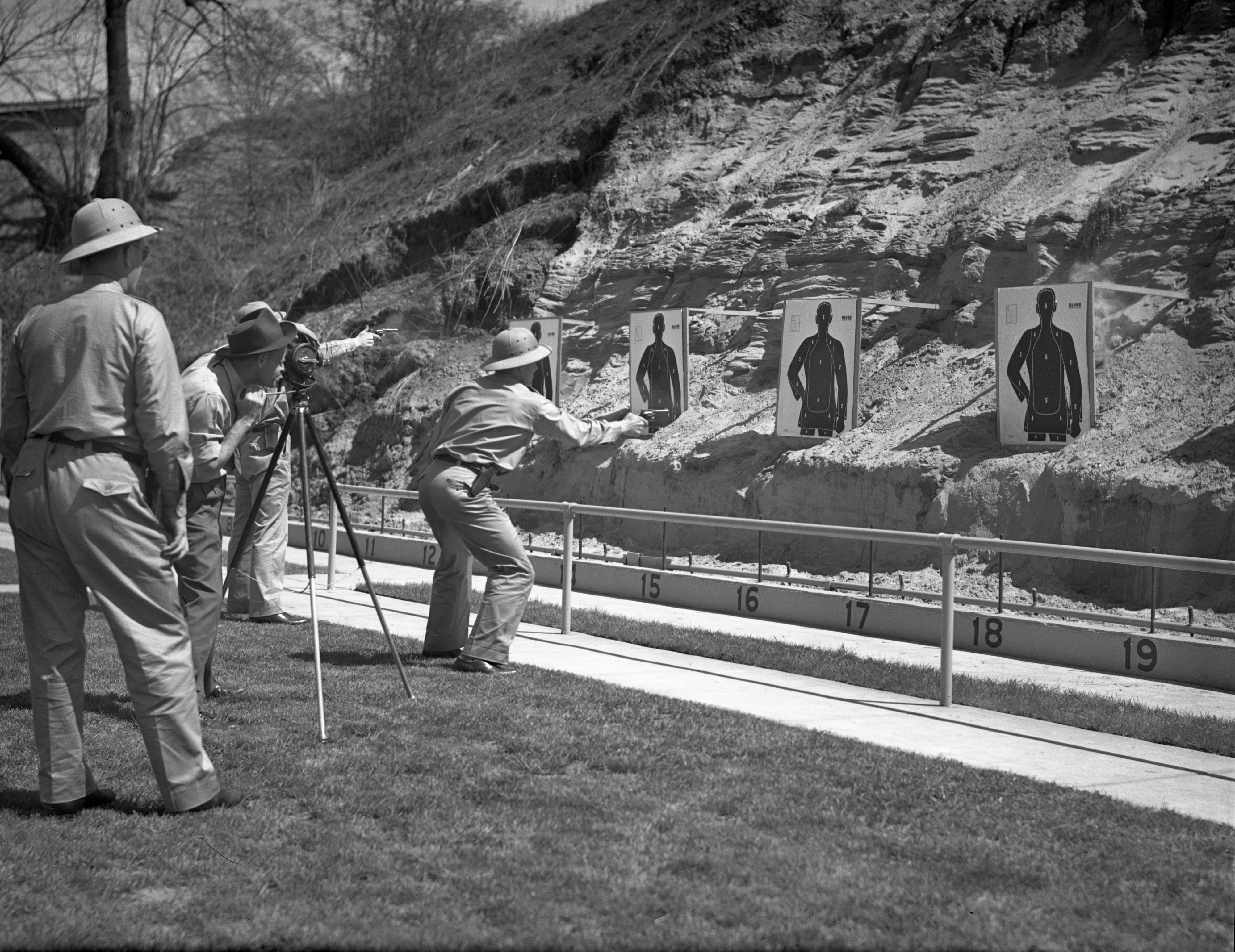 A Camera Operator For The FBI Films An Officer Shooting A Target At The Ann Arbor Police Pistol Range, May 1943 image