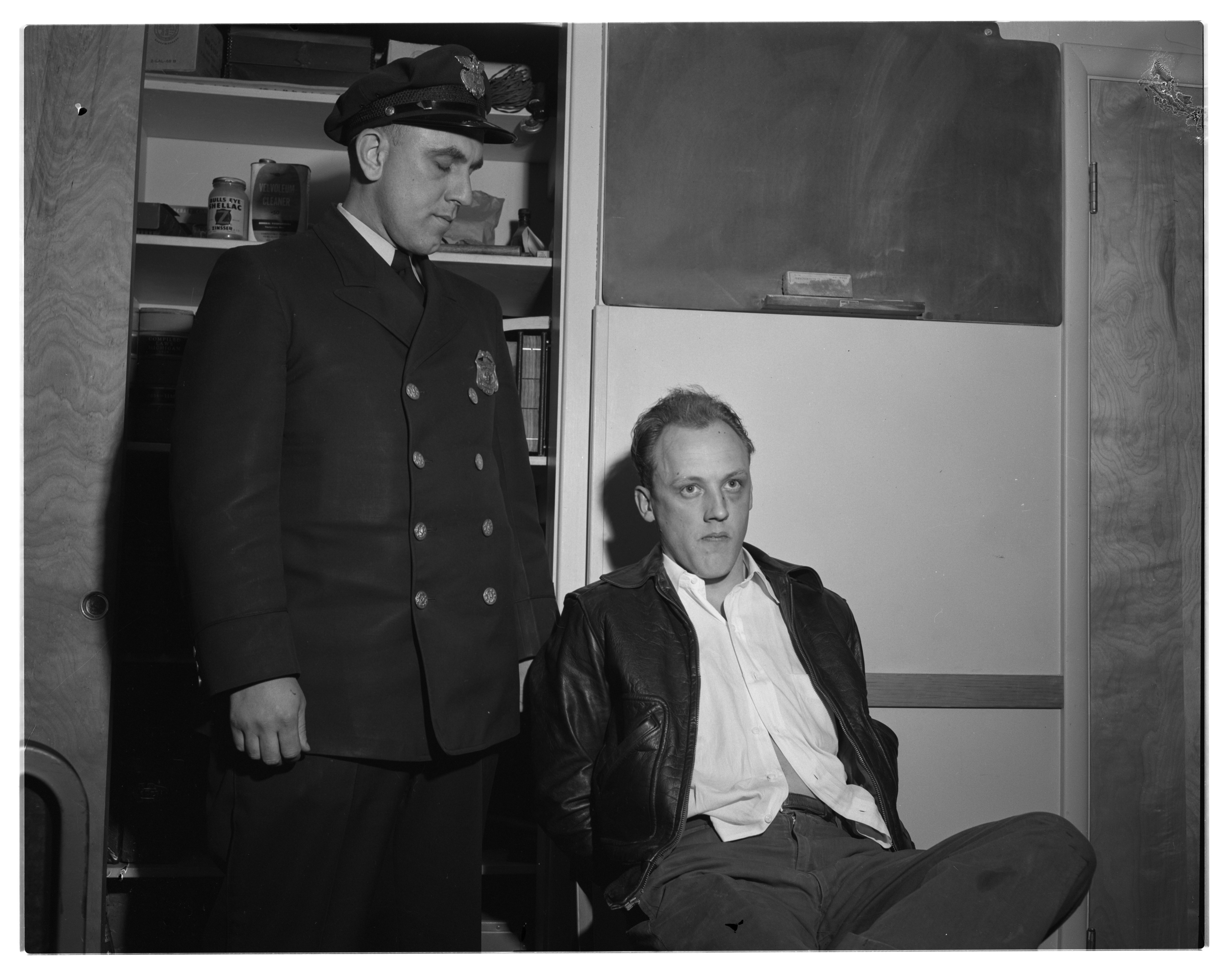Ann Arbor Police Officer George Miller With Pinckney Bank Robbery Suspect Robert Davidson, March 1956 image