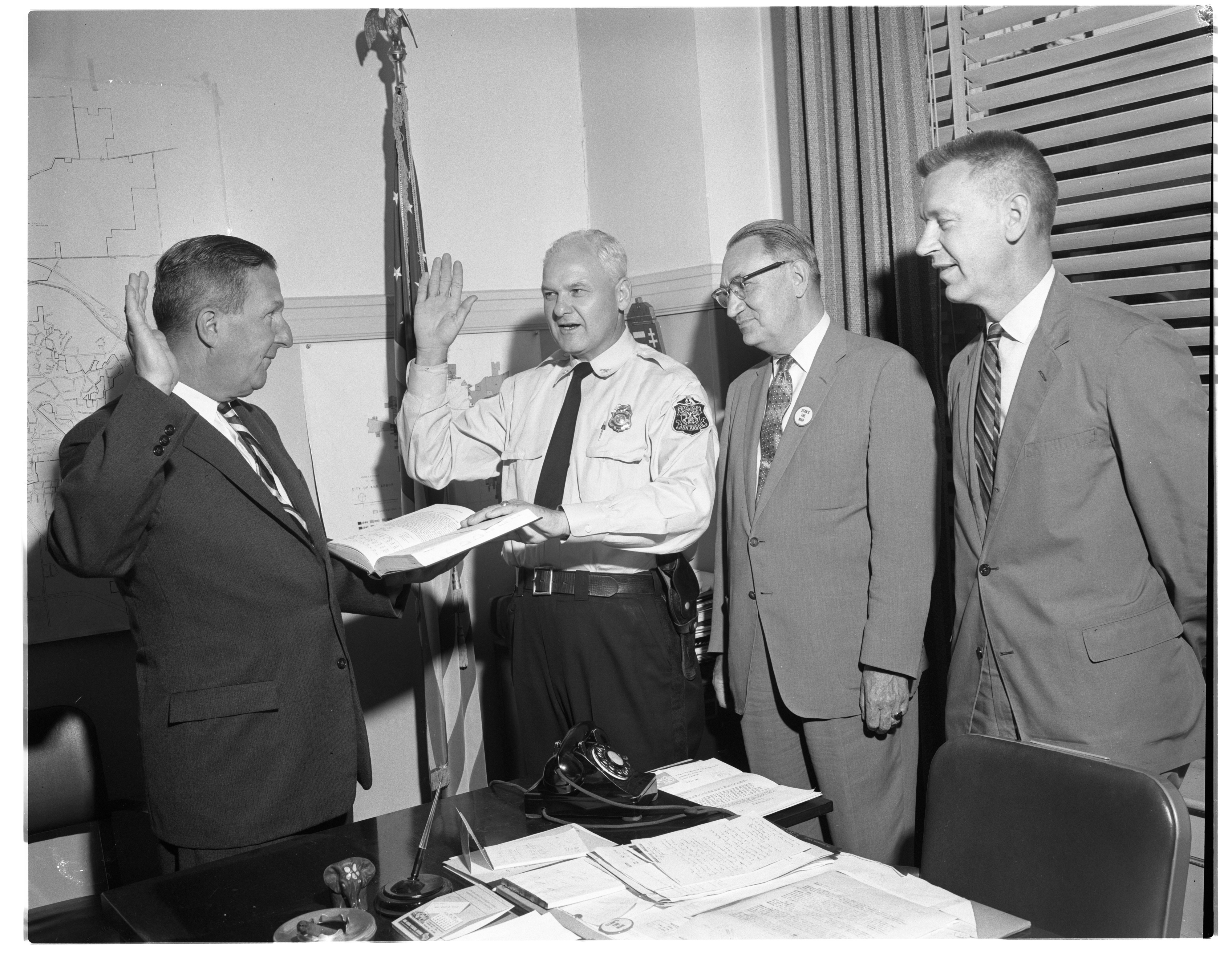 """Image from Swearing-In Ceremony For  Ann Arbor Police Chief Rolland J. """"Barney"""" Gainsley, July 1960"""