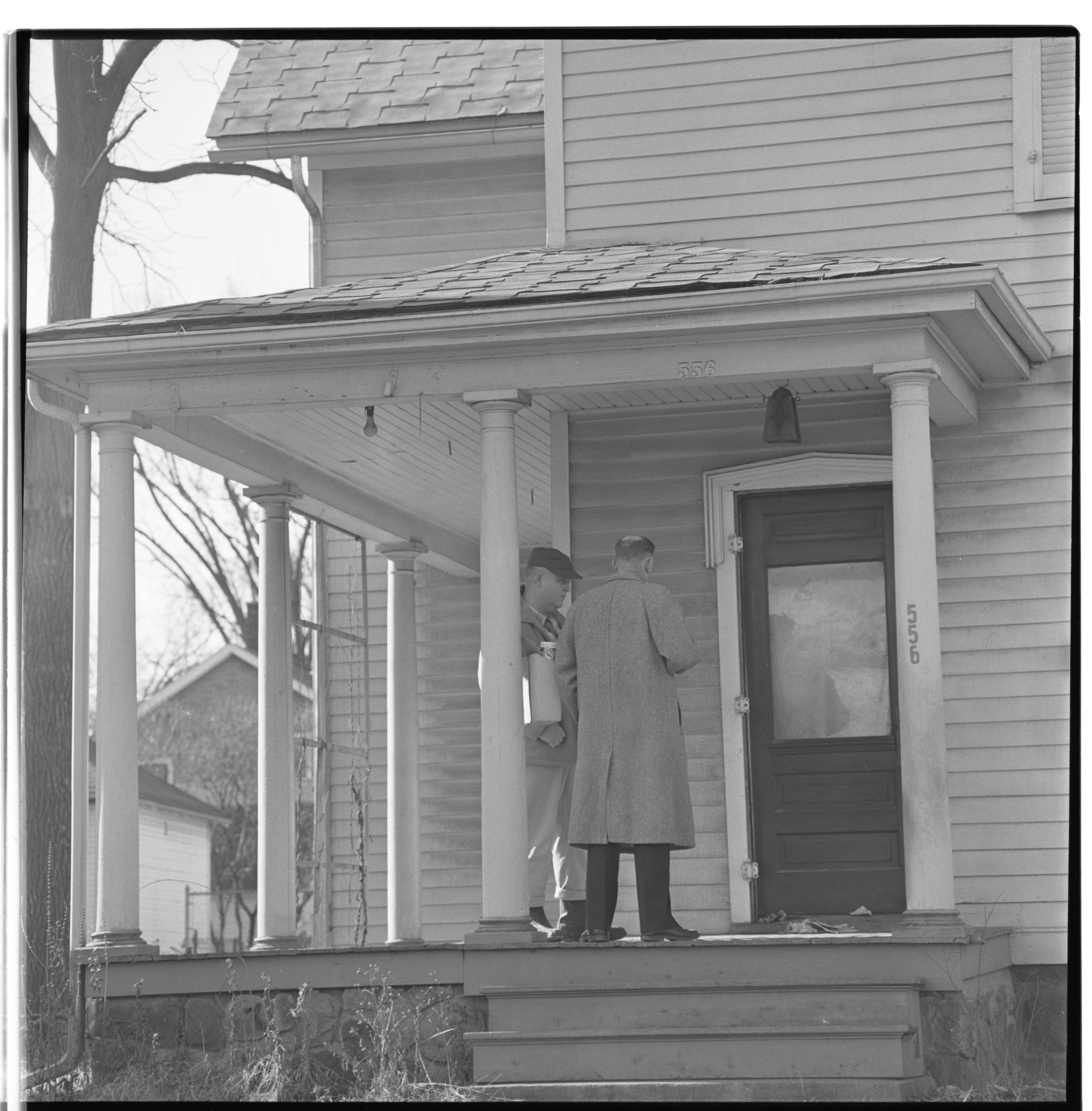 Ann Arbor Police Knocking On Door of Recluse Andrew Rowe, February 1961 image