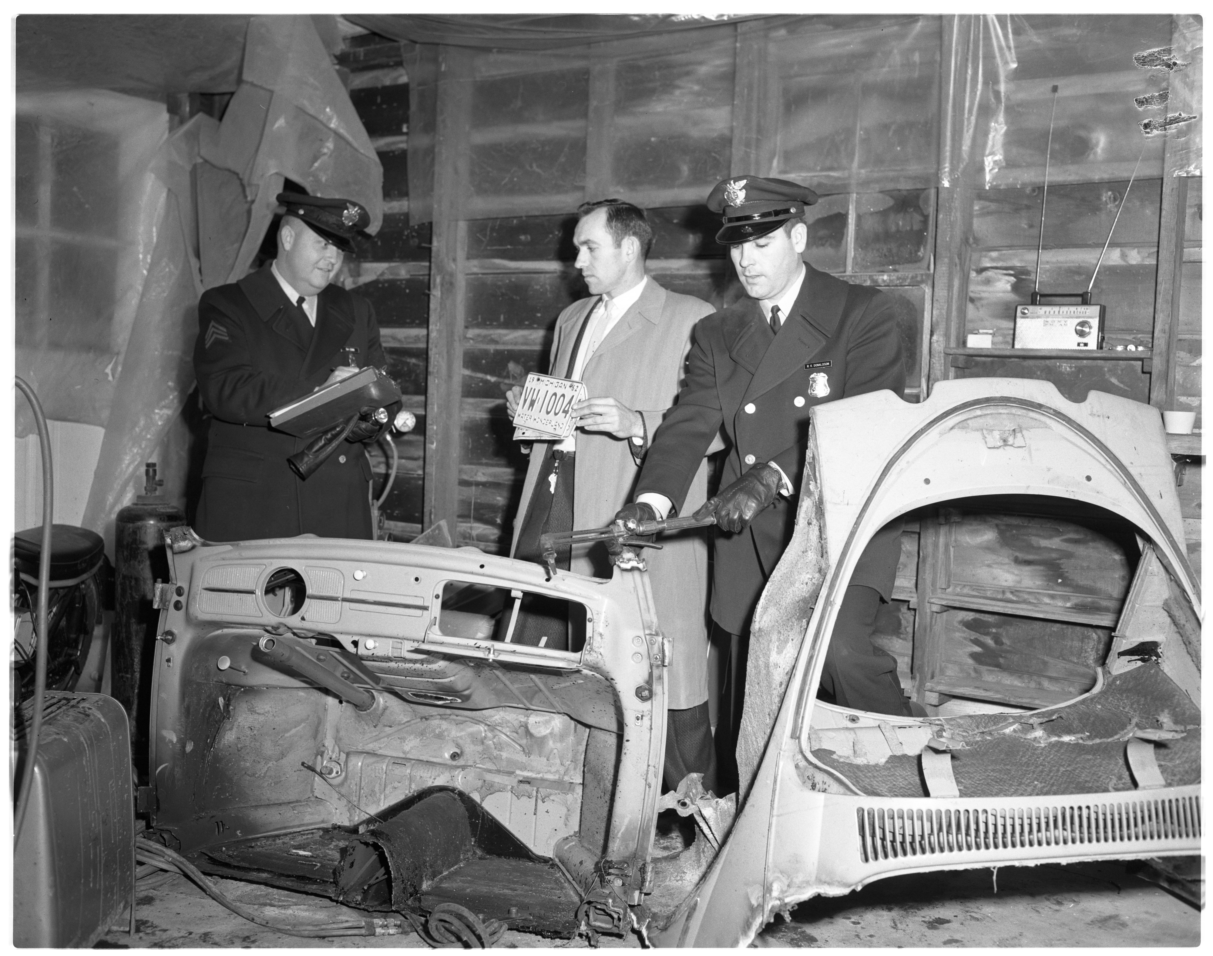 Ann Arbor Police Officers Take Inventory Of Stolen Automobile Parts, February 1963 image