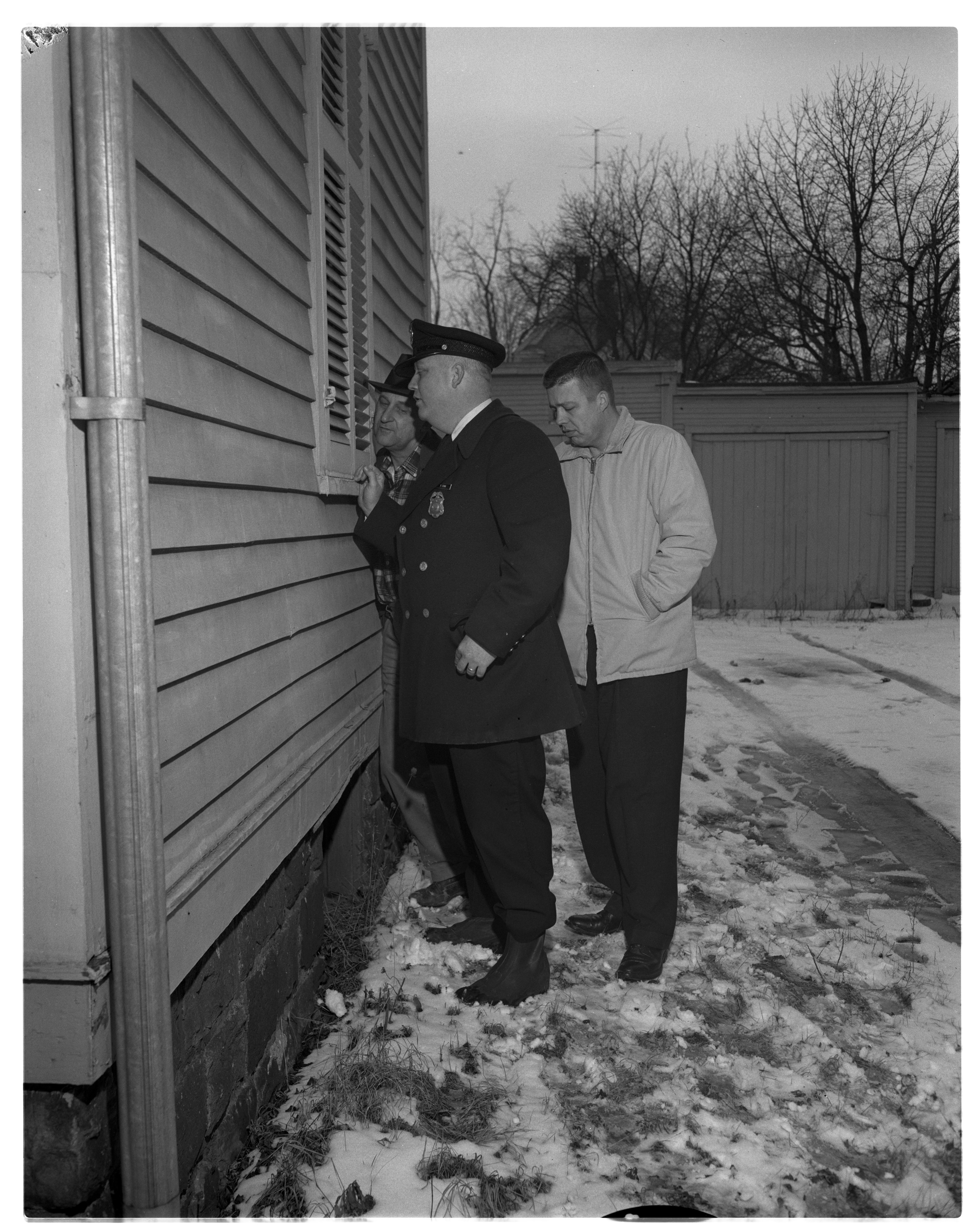 Ann Arbor Police Officers Talk To Recluse Andrew Rowe, February 1961 image