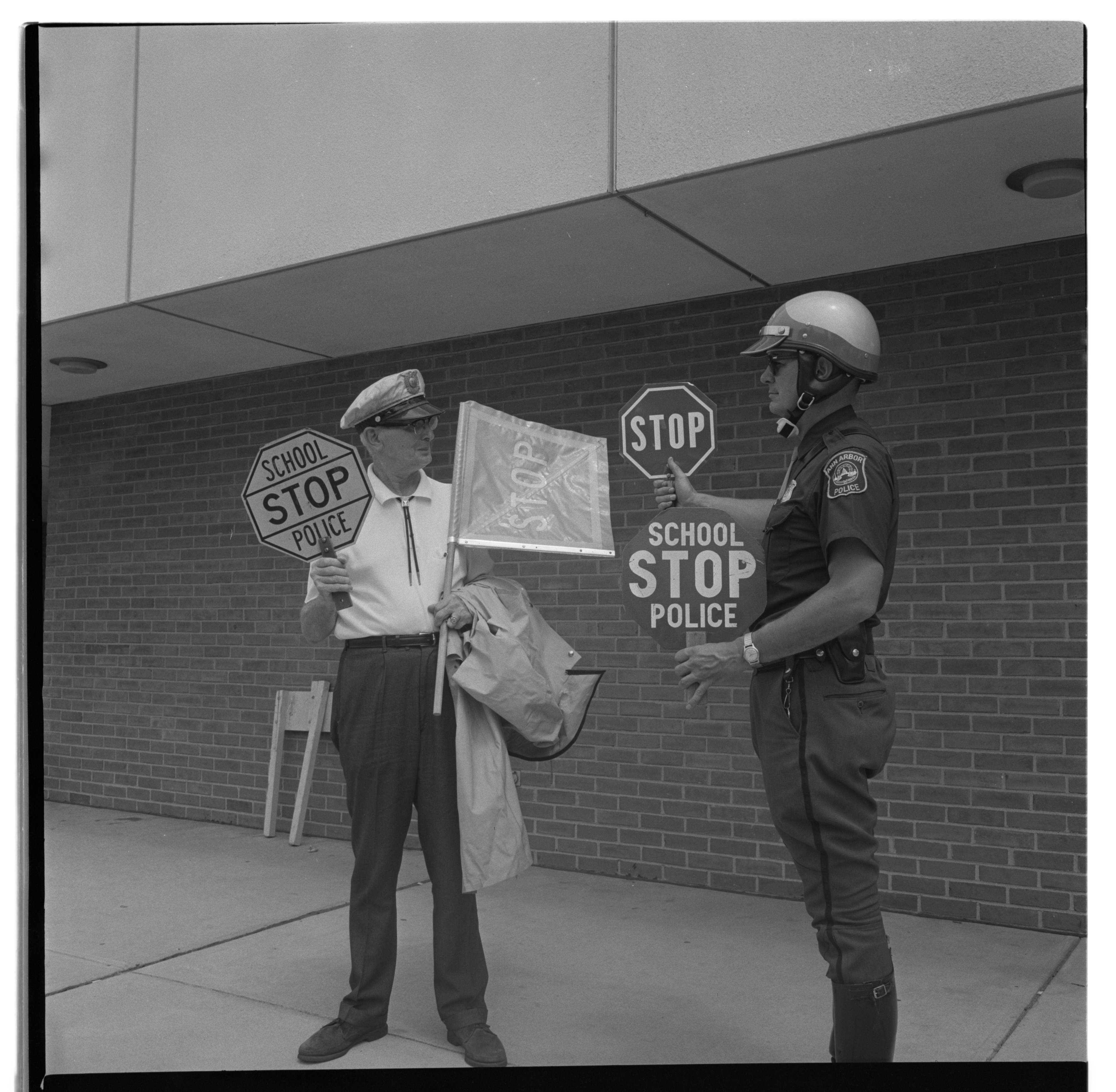 Ann Arbor Police and Crossing Guards Get Read For School Year, August 1966 image