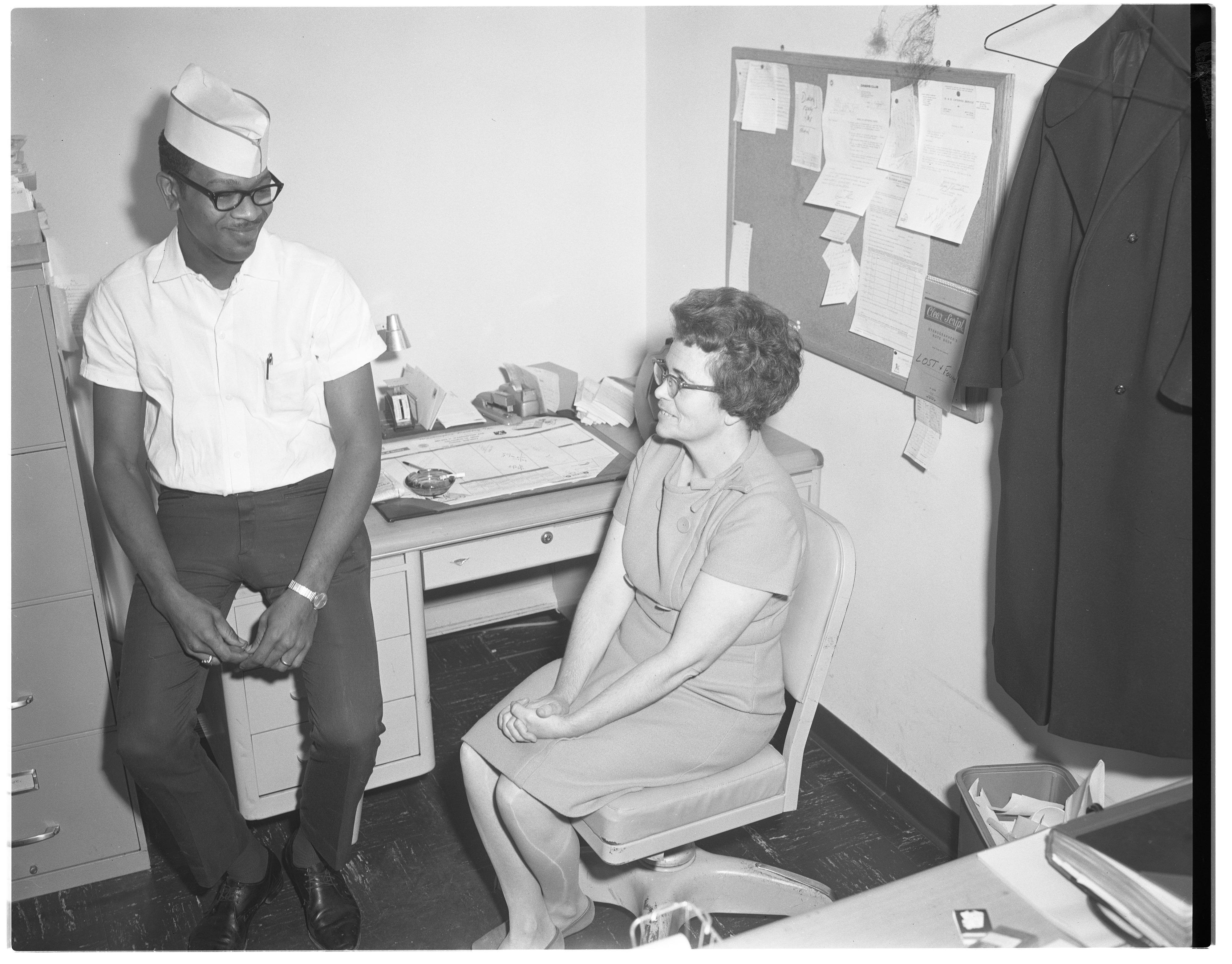 Holiday Inn West Employees Discuss Robbery, October 1966 image