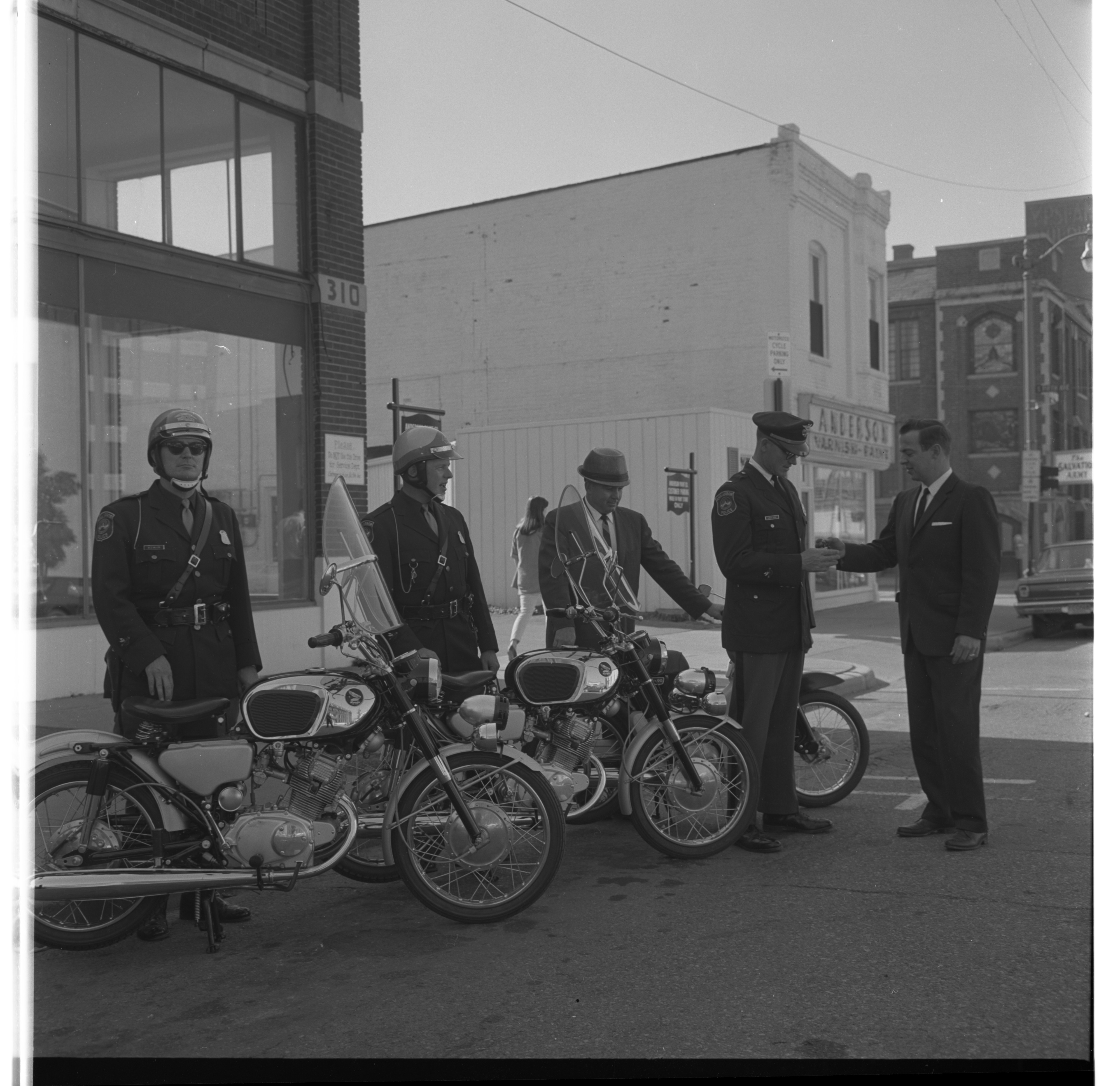 Ann Arbor Police Accept Keys To New Motorcycles Purchased From Downtown  Honda Co., November 1966
