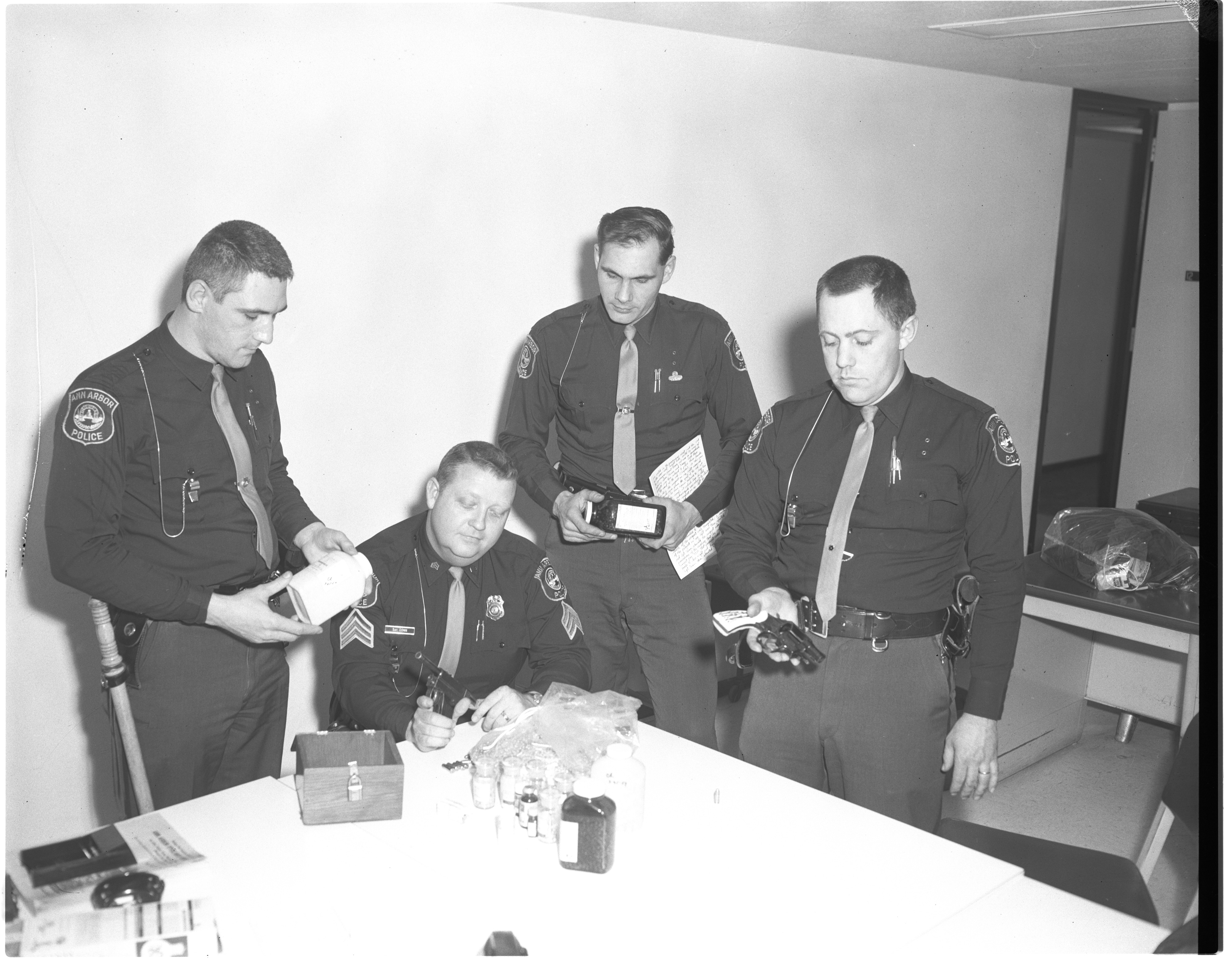 Ann Arbor Police Officers Check Seized Guns and Narcotics, March 1967 image