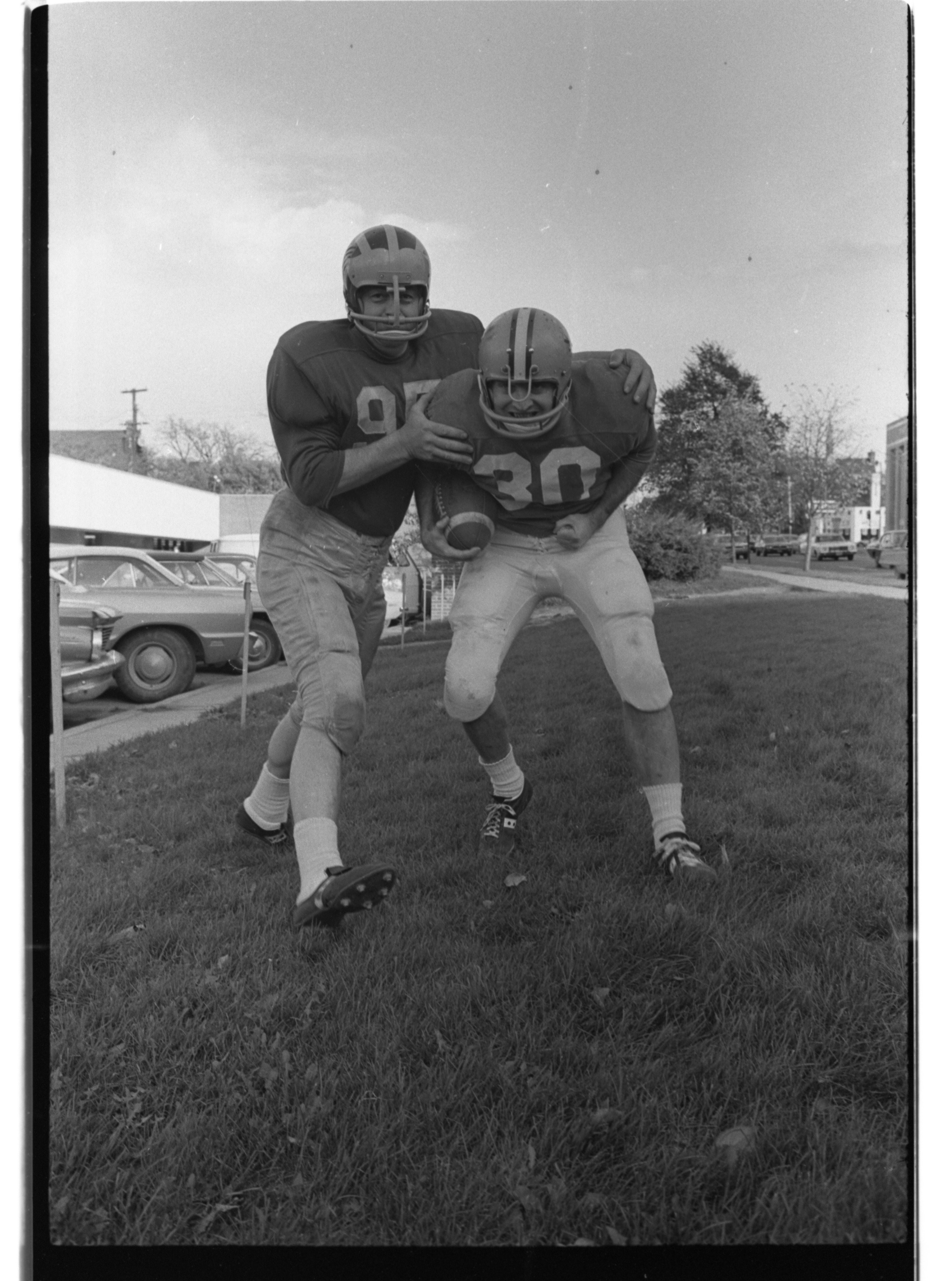 Washtenaw County Sheriff's  and Ann Arbor Police Players Practice for Annual Pig Bowl Game, November 1971 image