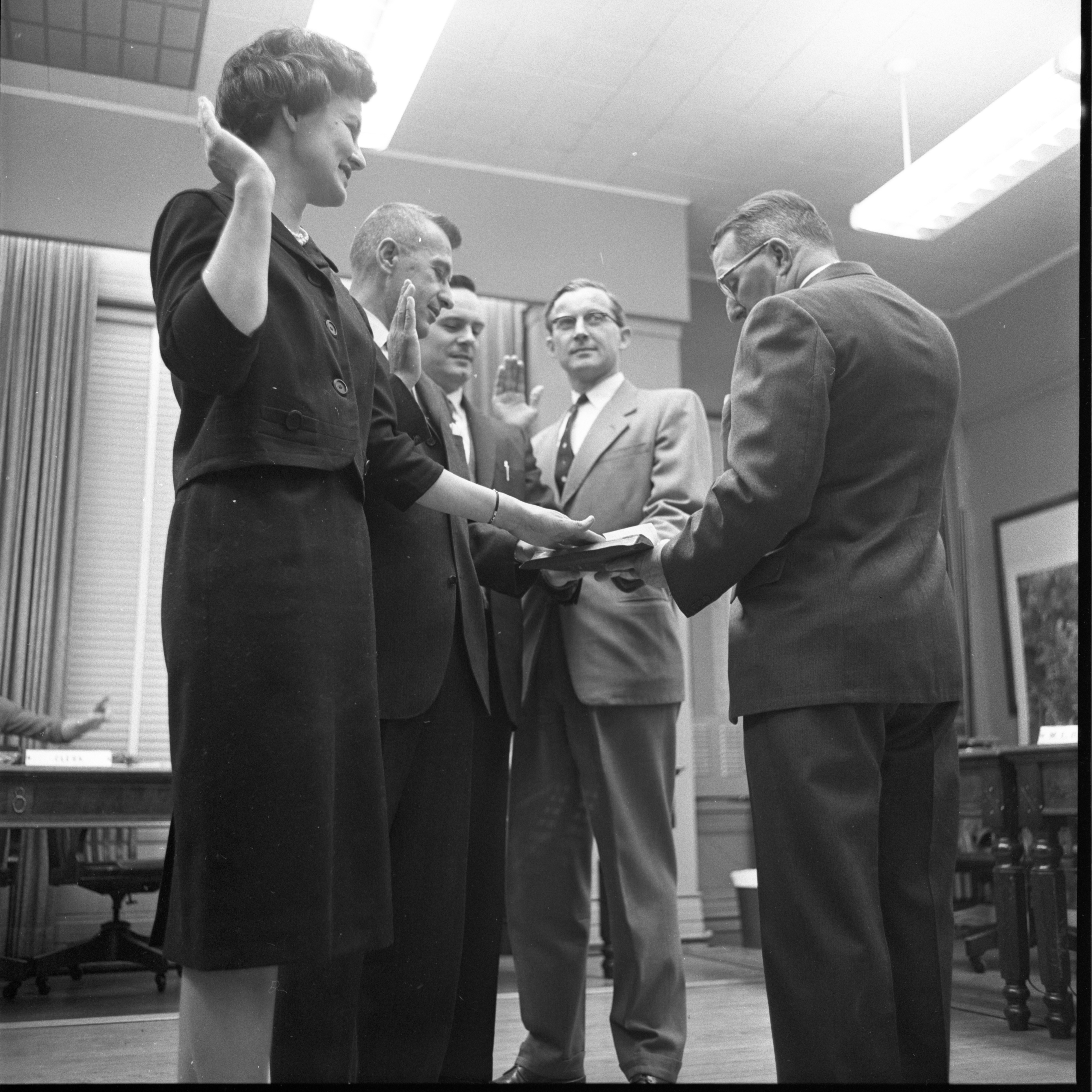 Image from Ann Arbor City Councilmen Take Oath Of Office, April 1962