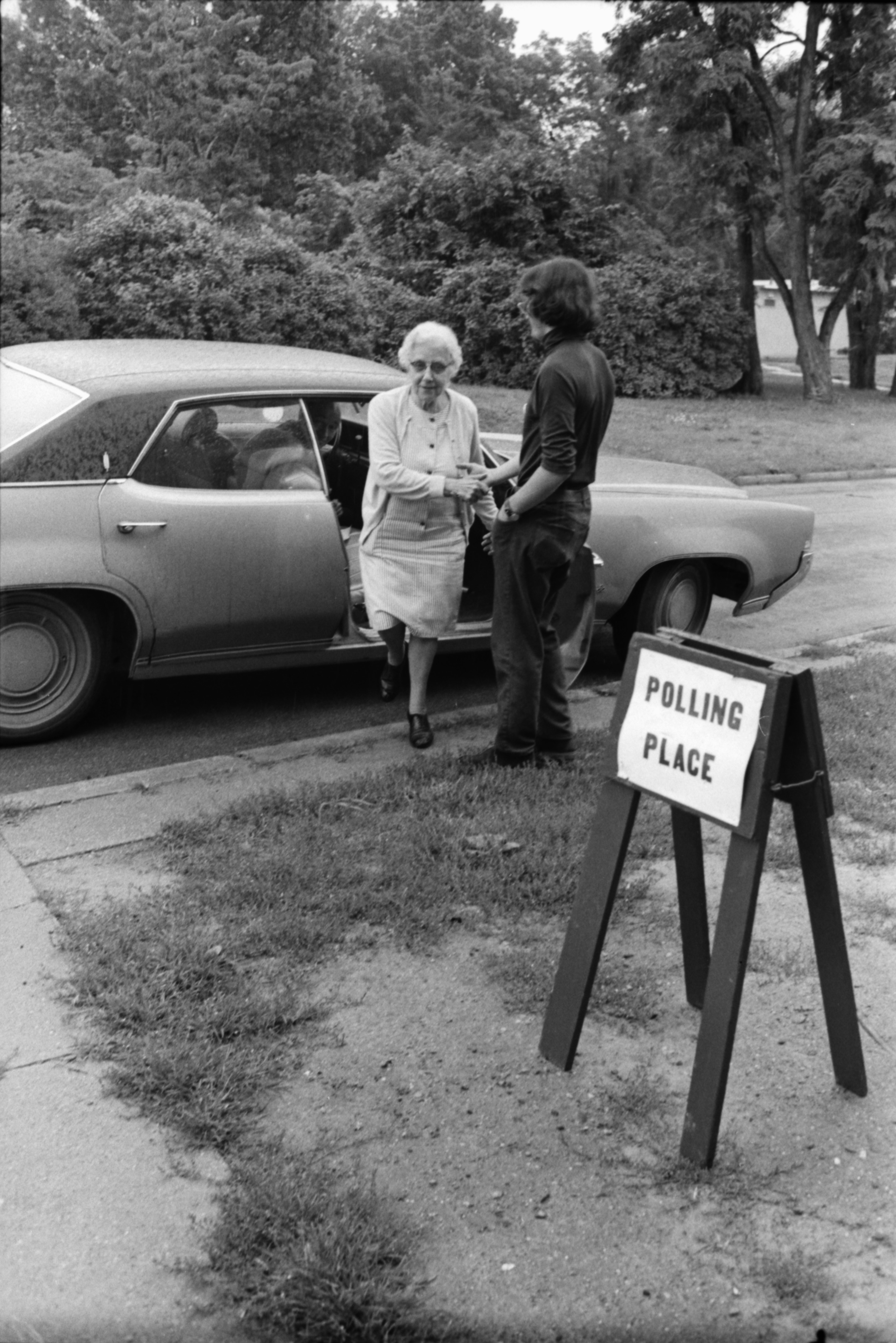 Mrs. Catherine Heinzmann On Way To Vote, Helped by Tom Daniels, August 1972 image