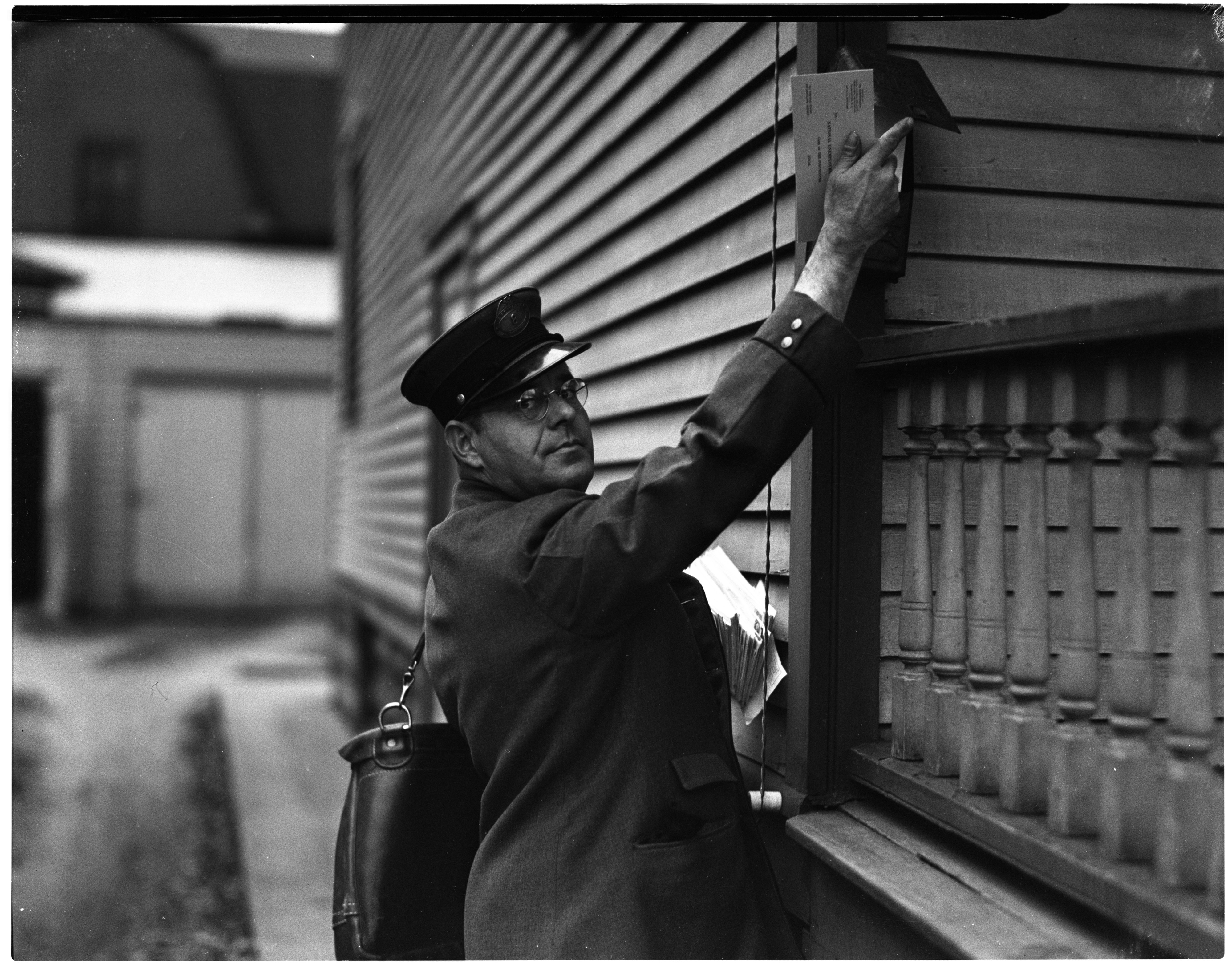 Mail Carrier Delivering Blank Forms for Unemployment Census image