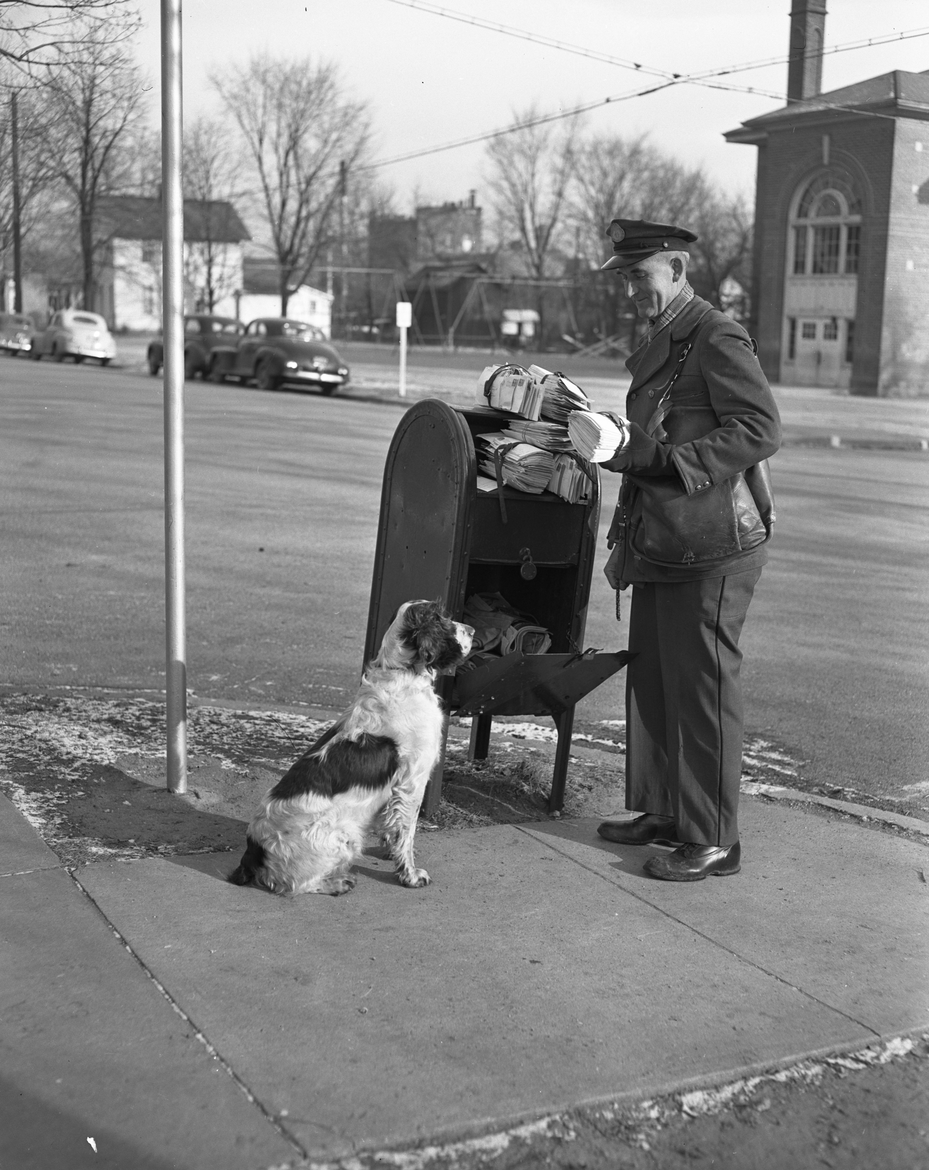 Mailman Ernest Pommerening and his dog Bounce, December 1949 image