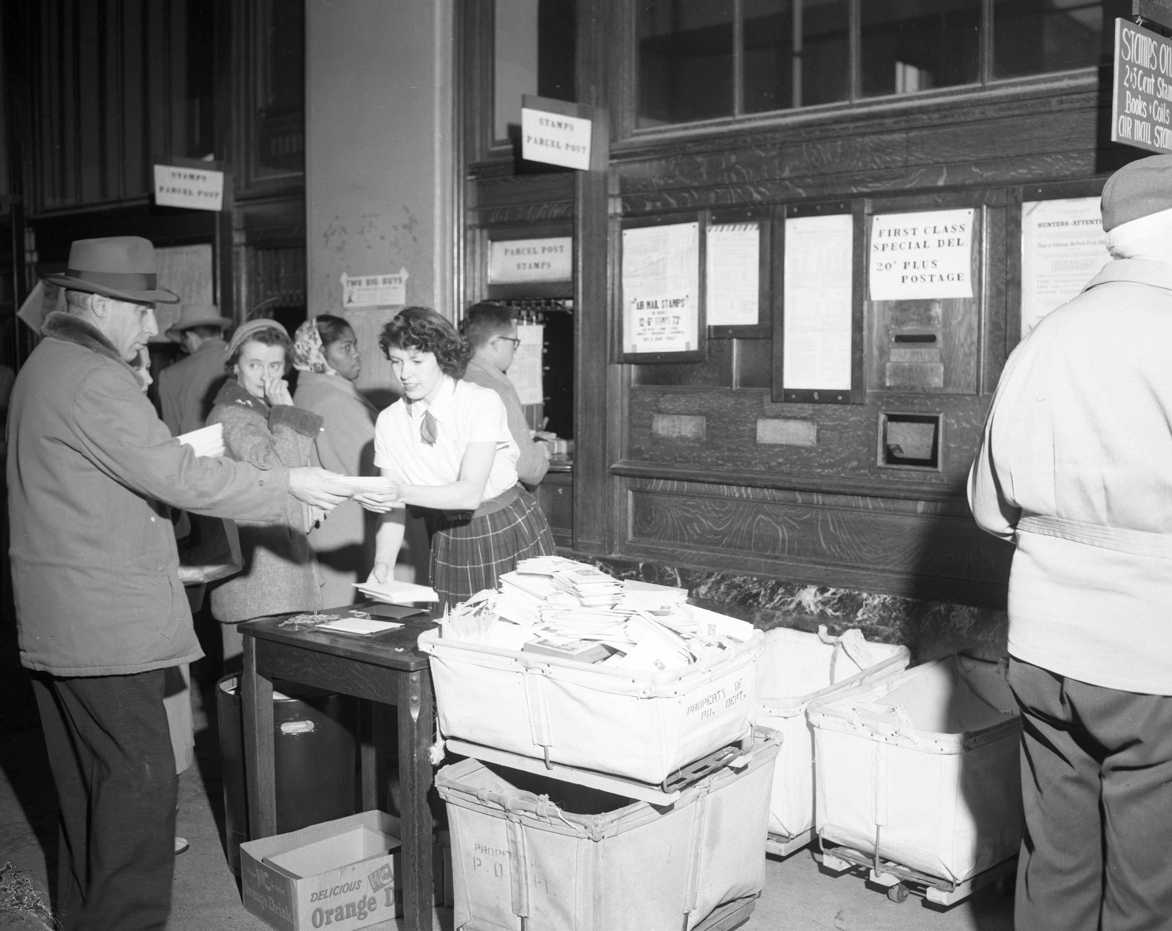 A busy Christmas season at the Ann Arbor Post Office, December 1955 image