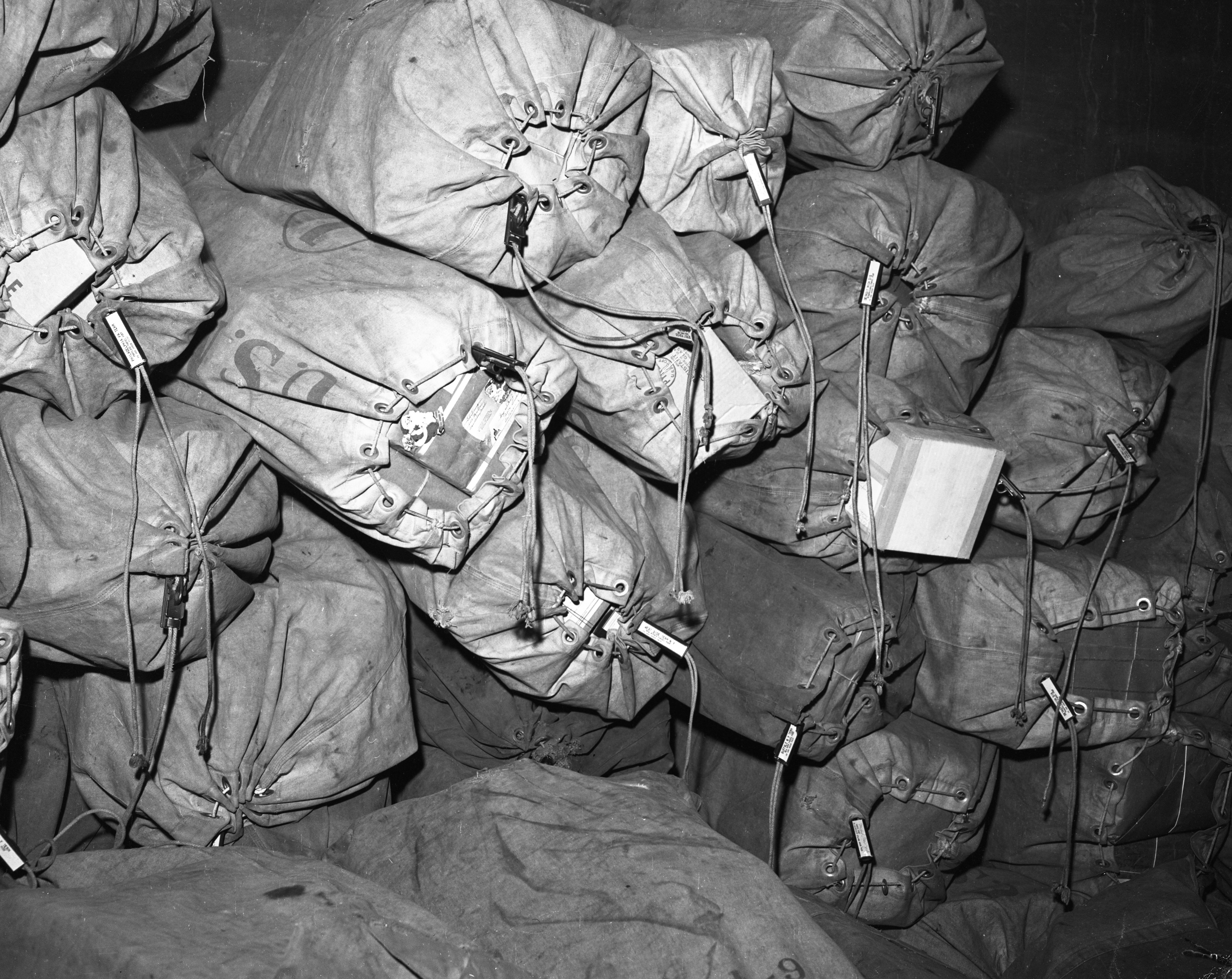 Bags of post at the Ann Arbor Post Office during the Christmas rush, December 1955 image
