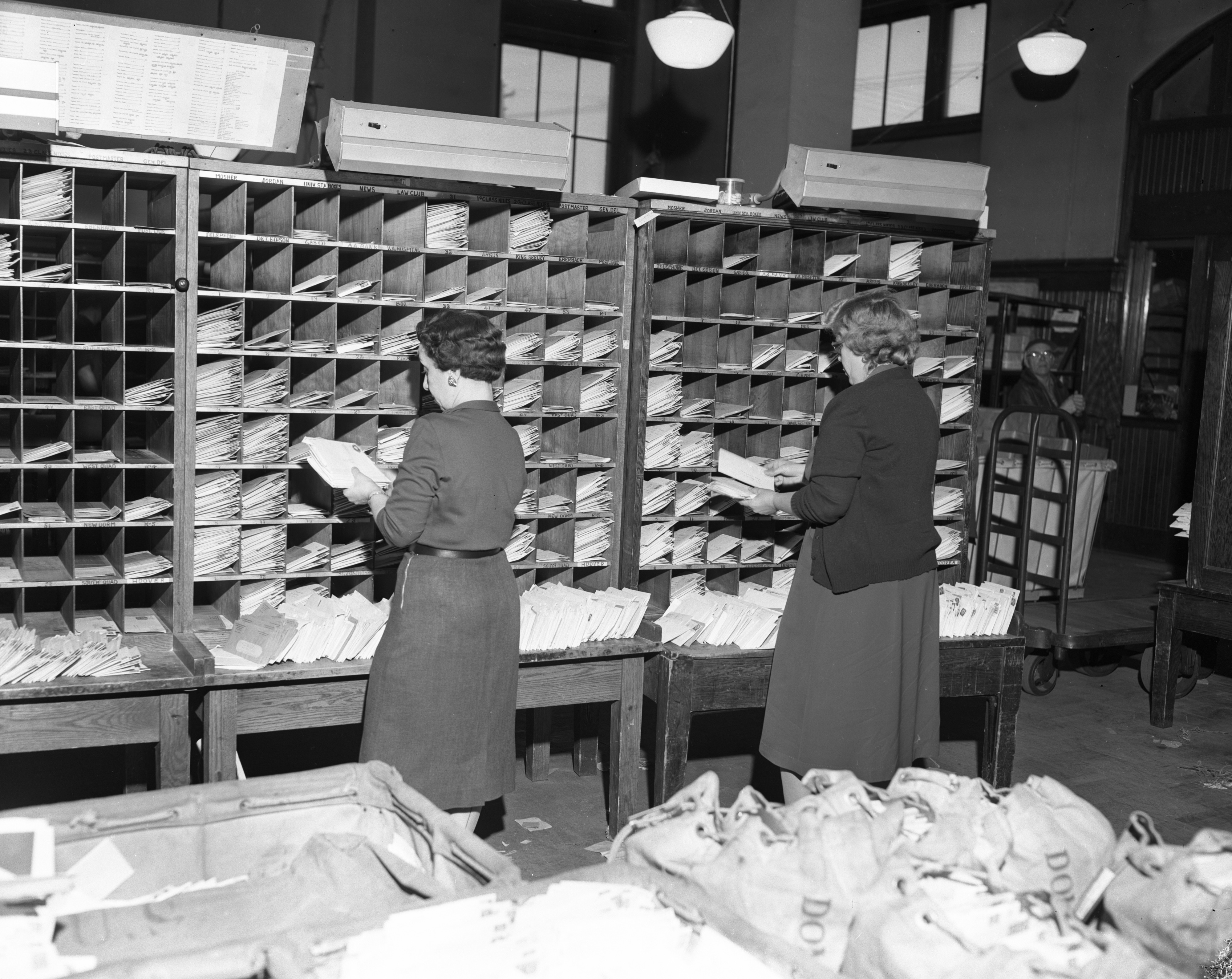 Sorting greeting cards during Christmas rush at the Ann Arbor Post Office, December 1955 image