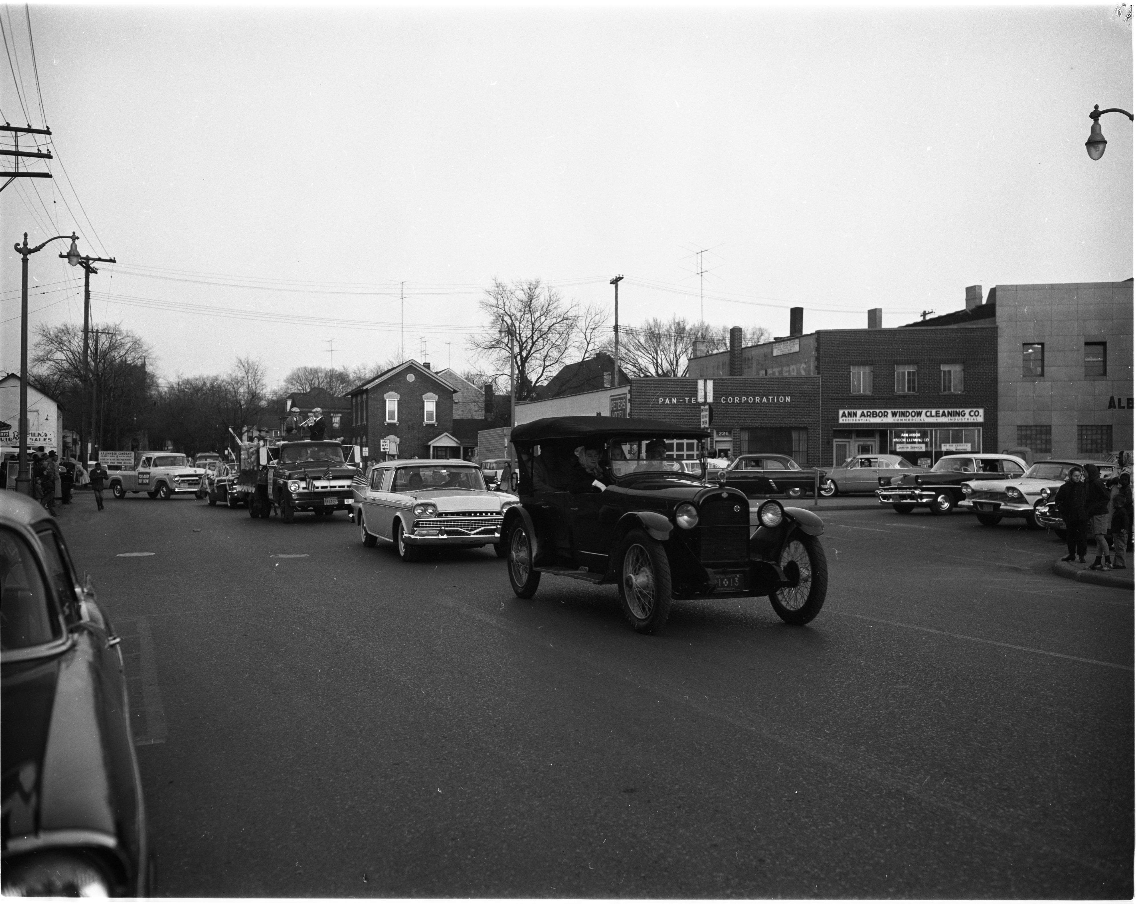 'Auto Buy Now Parade' Goes Through Ann Arbor, April 1958 image