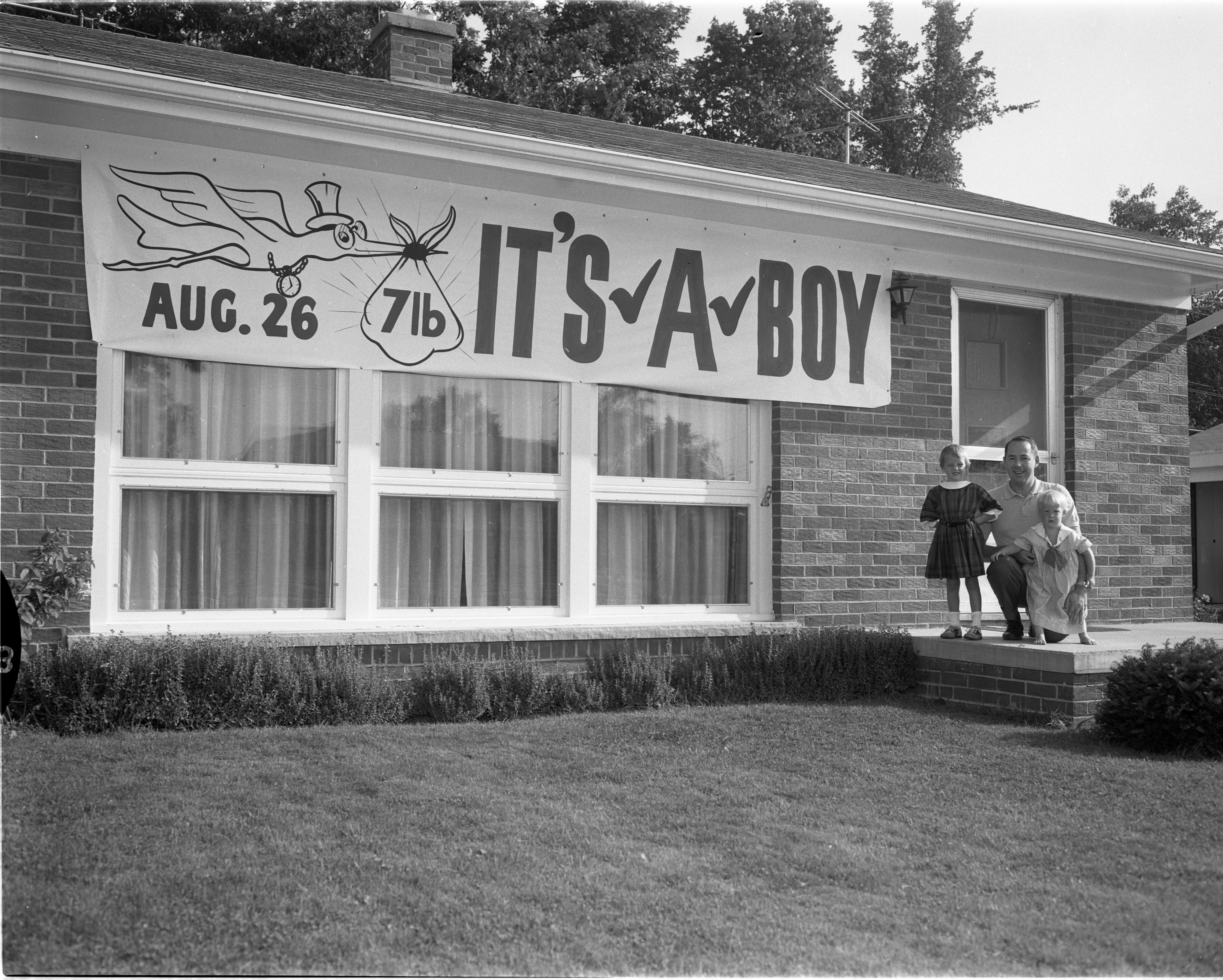 Sign Announces 'It's A Boy' Outside Home Of New Parents Dr. and Mrs. Robert A Aldrich, August 1959 image