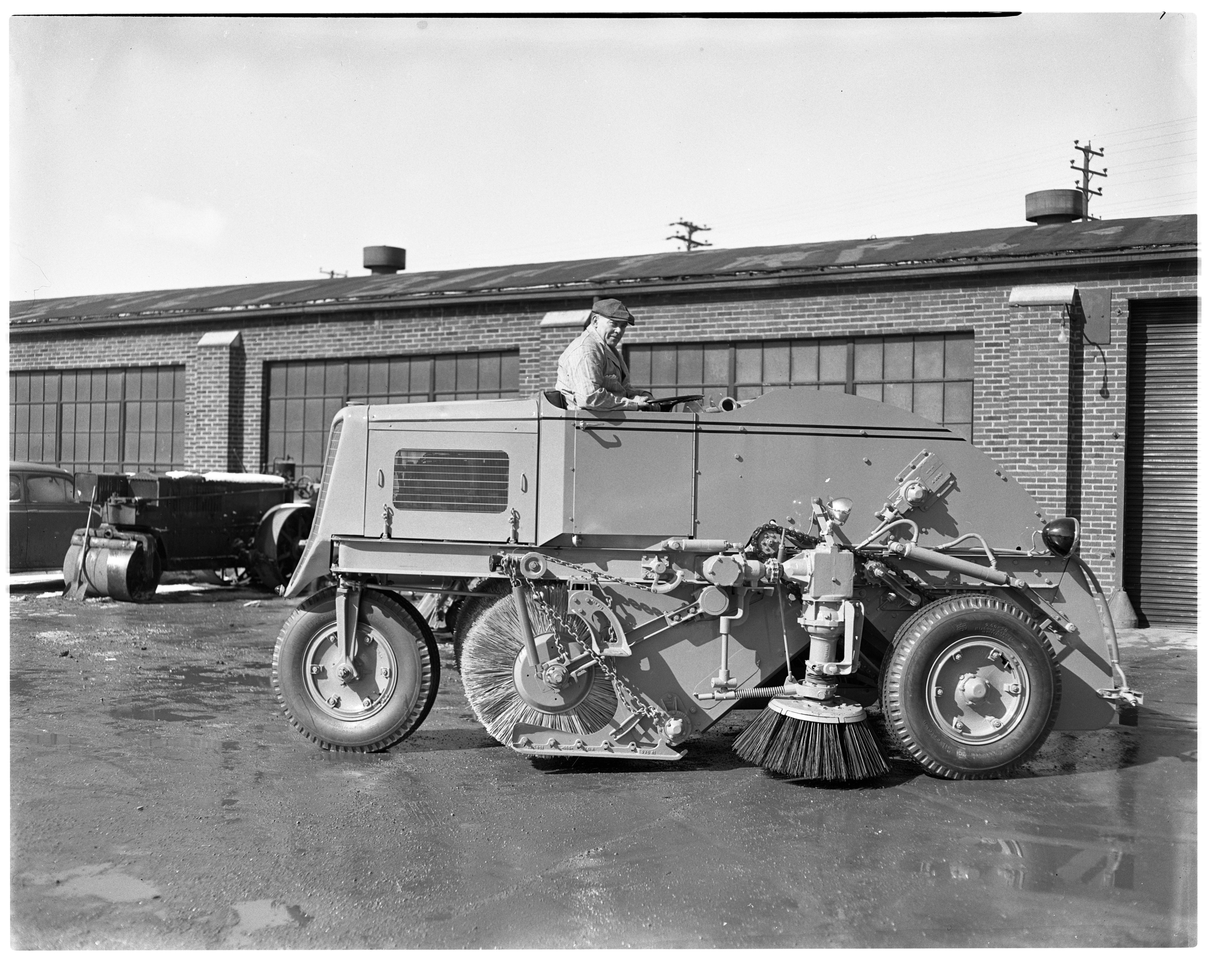 Leslie Bird Tests Out Ann Arbor's New Street Sweeper, March 1949 image