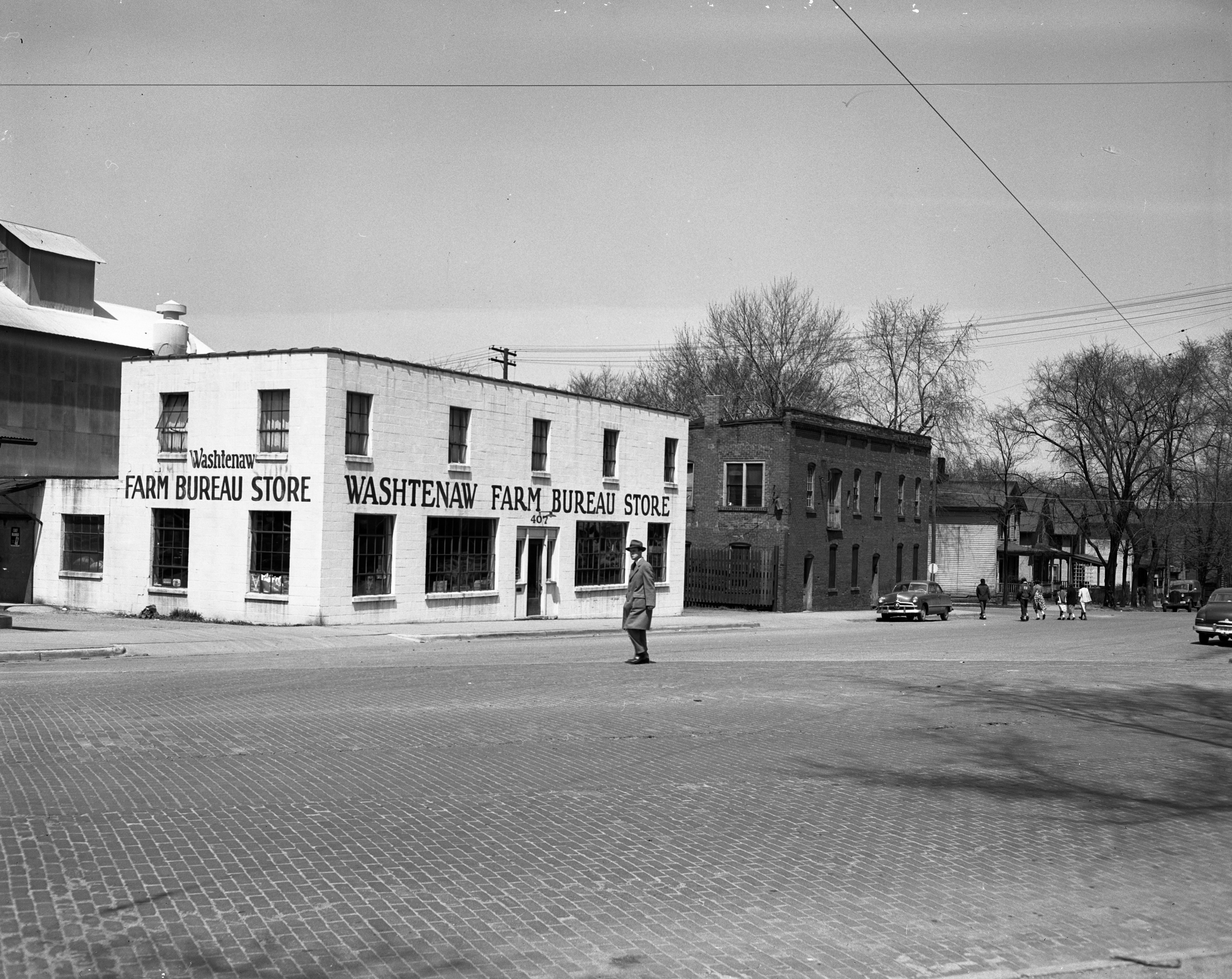 Farm Bureau Store on N. 5th Avenue (west side of street just north of Detroit St.), May 1950 image