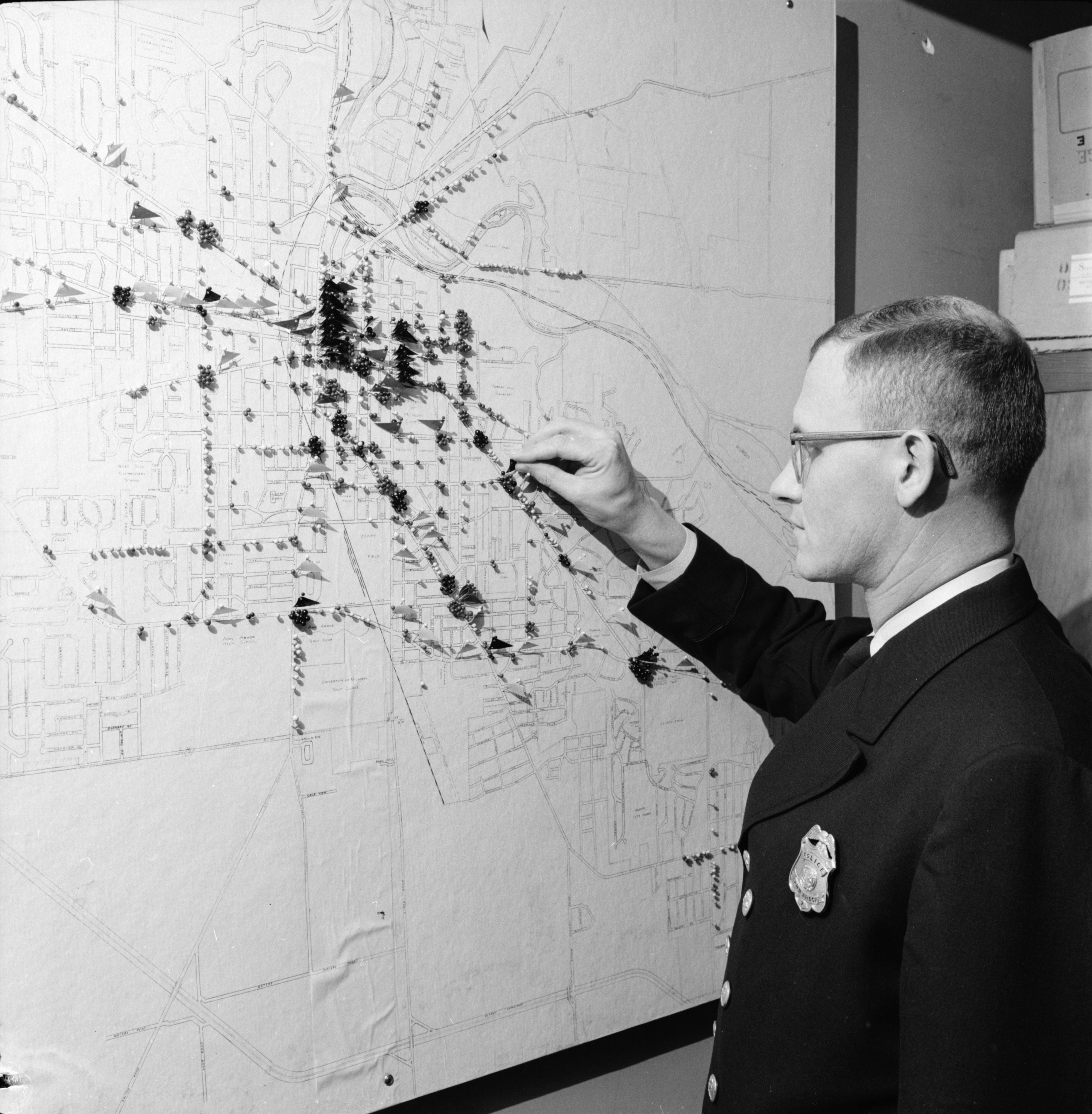Patrolman Howard R. Zeck and Ann Arbor Police Department Traffic Bureau Chart, January 1959 image