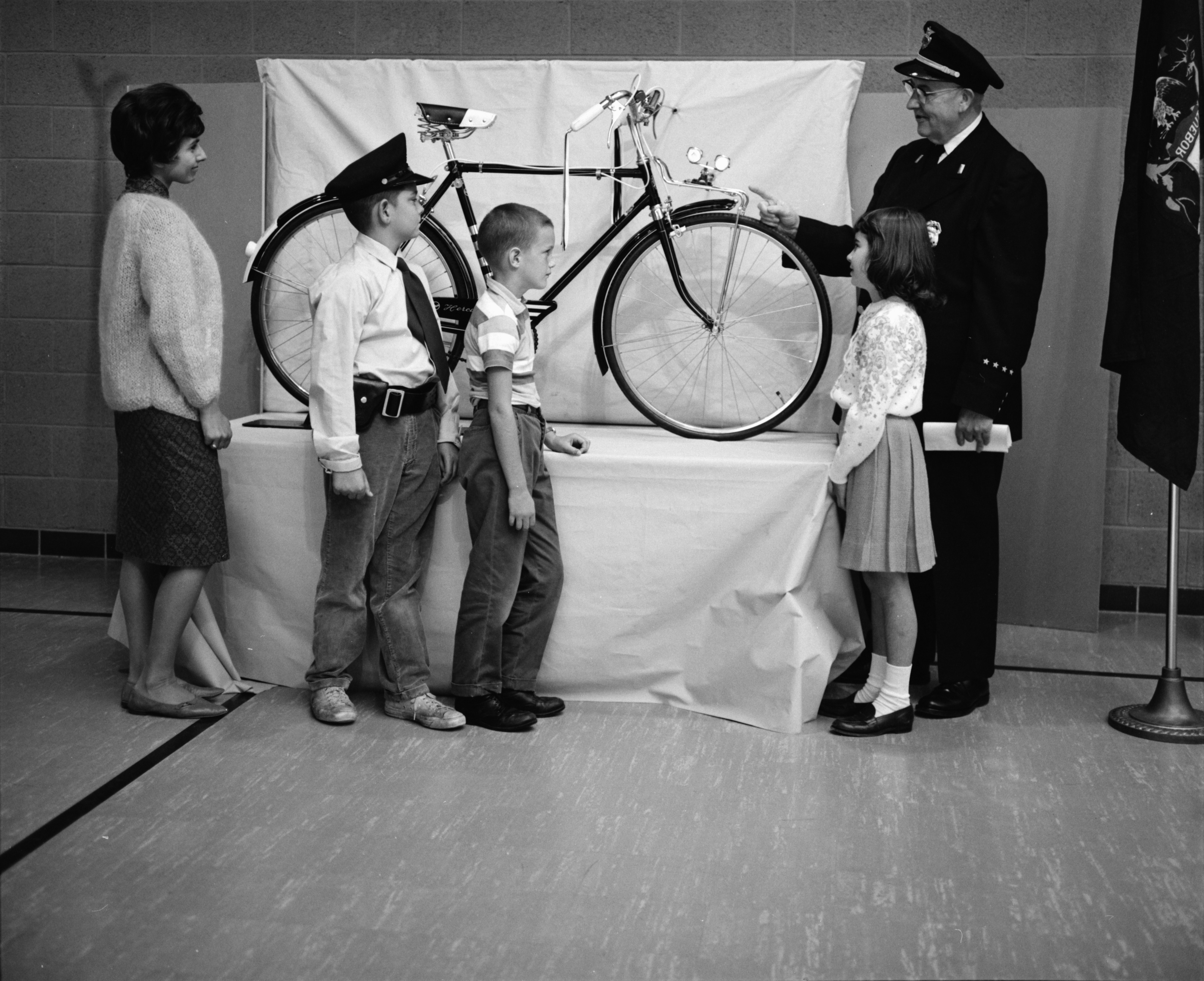 "Ann Arbor Police Department Lt. George J. Simmons Explains ""Talking Bicycle"" to Students at Allen School, September 1962 image"