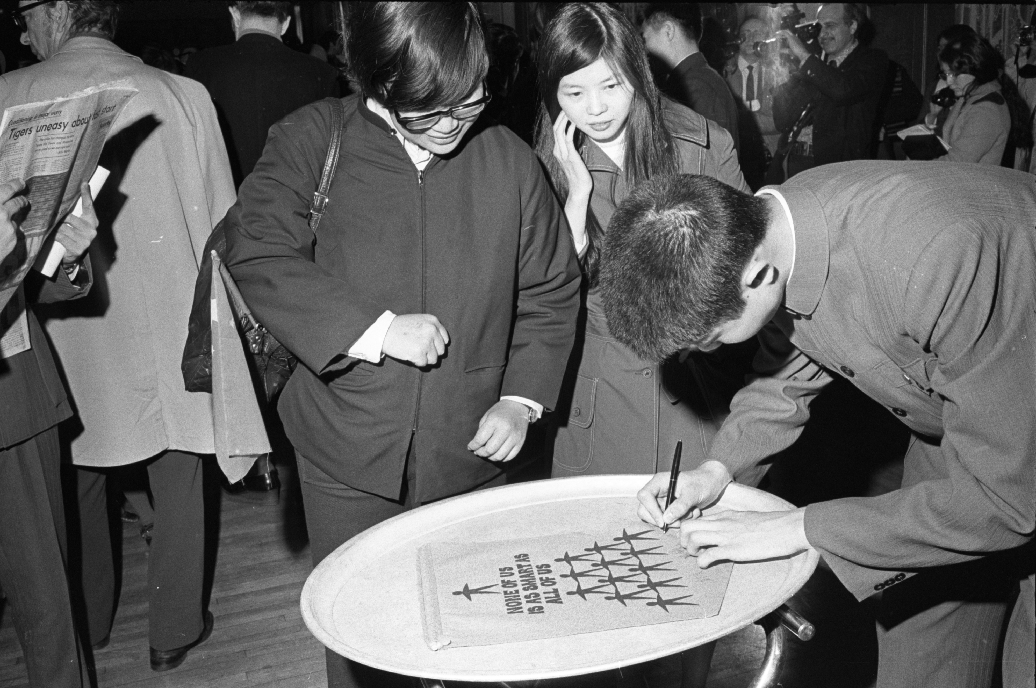 Guests From China Add Signatures To Poster During Reception At Michigan Union, April 1972 image