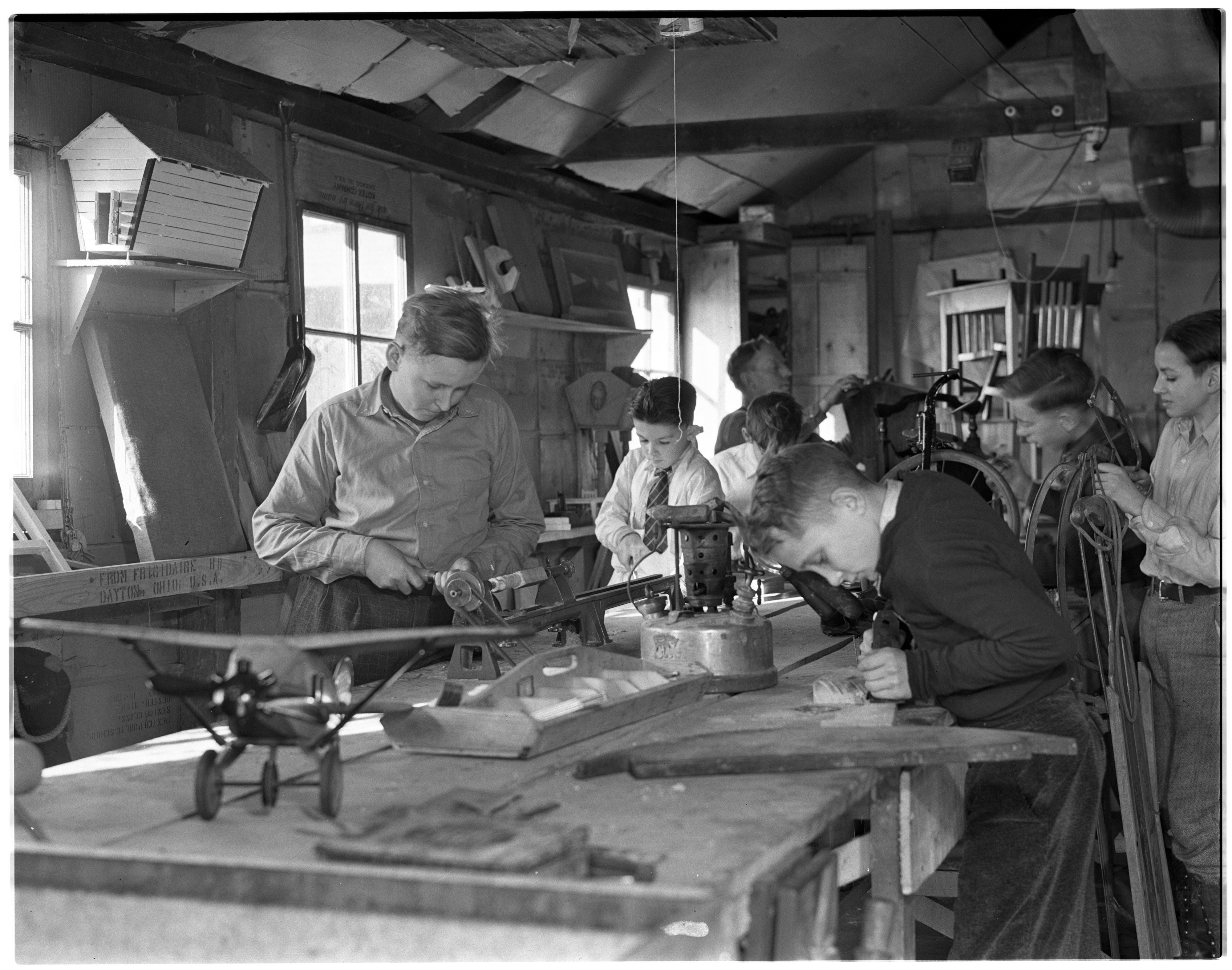 Boys in Workshop Making Toys, Dexter image
