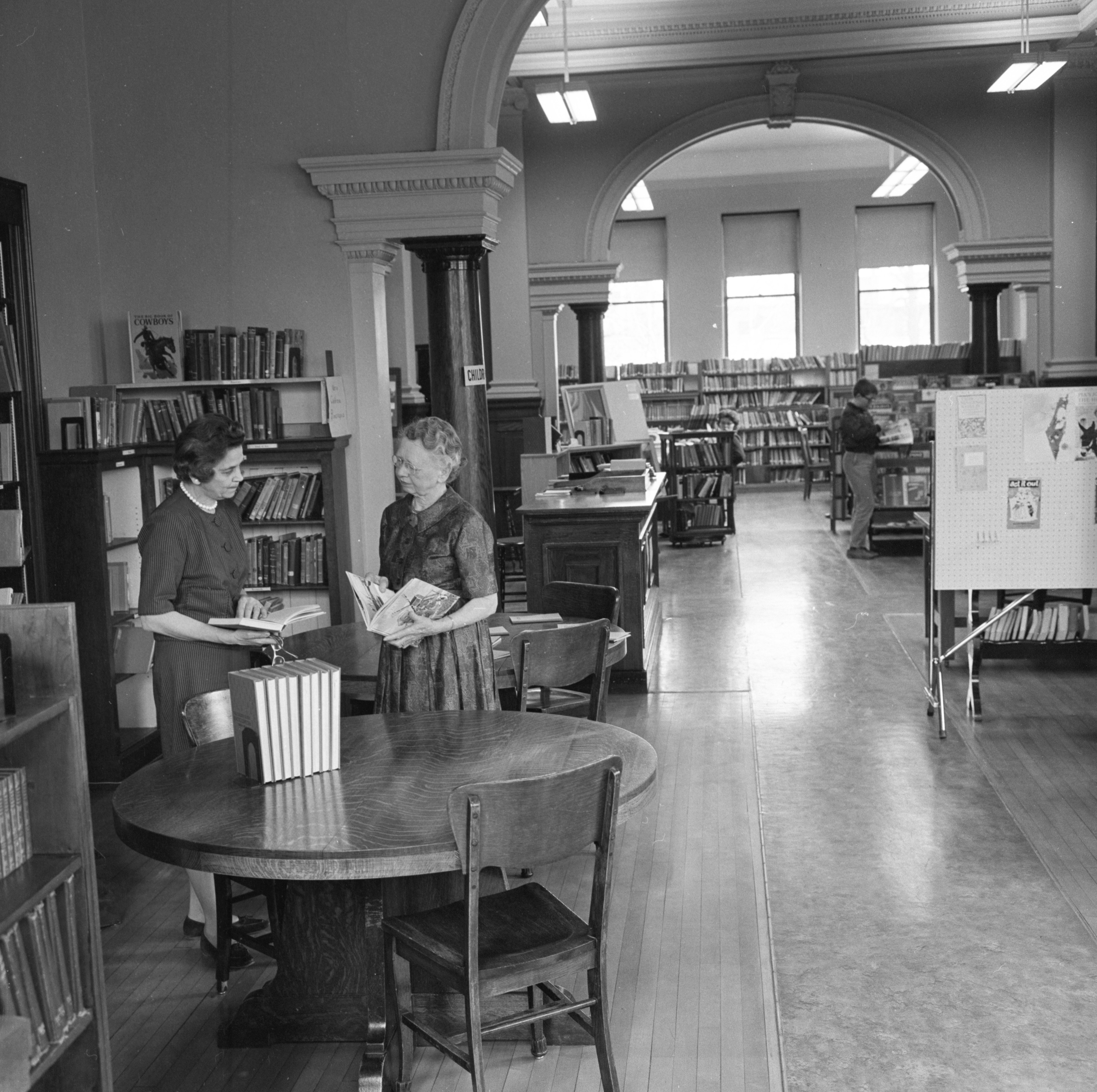 Librarians Chat In The Children's Room Of Howell's Carnegie Library, April 1963 image