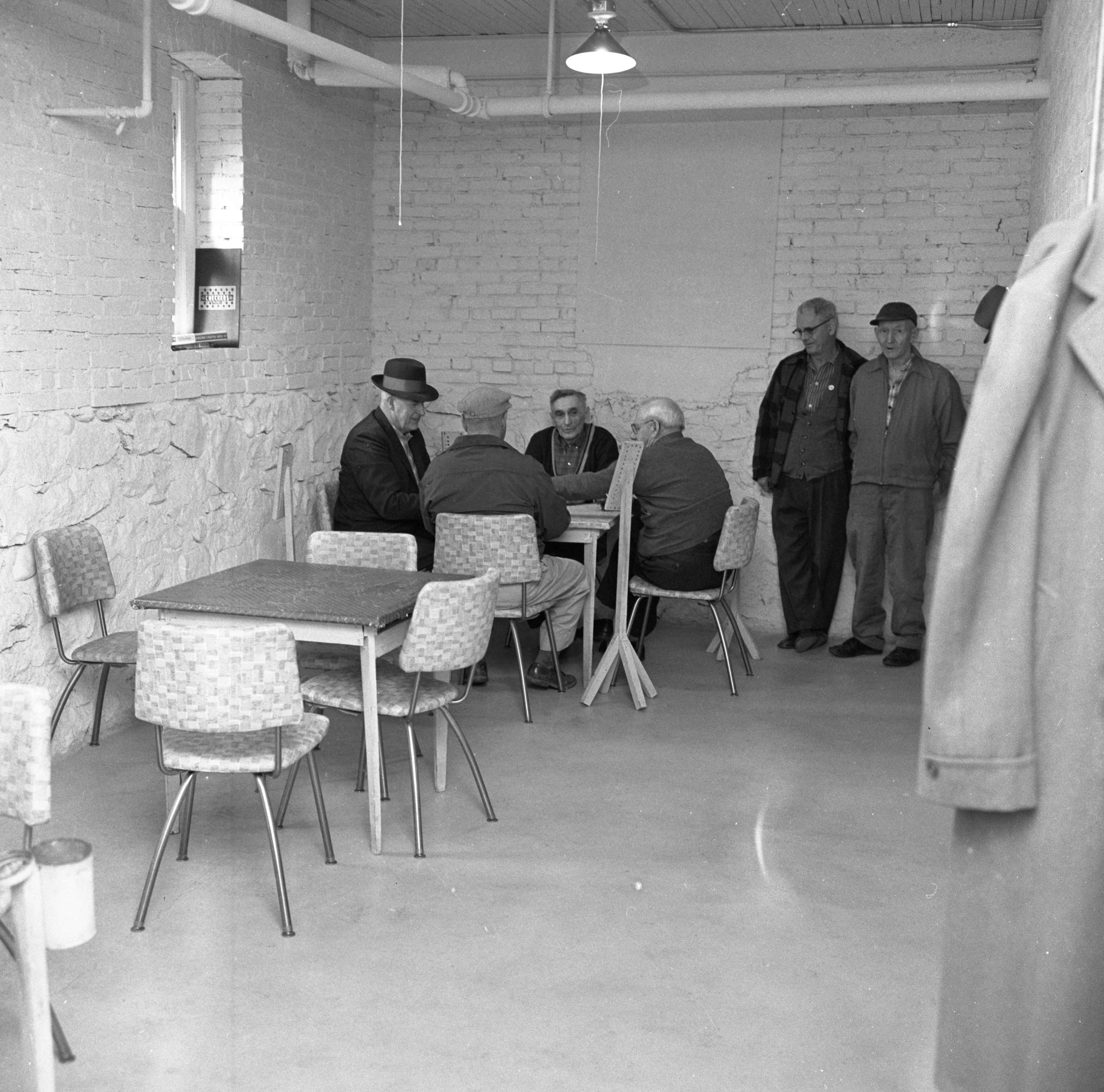 Members Of The Senior Citizens' Euchre Club Enjoy A Game In Howell's Carnegie Library, April 1963 image