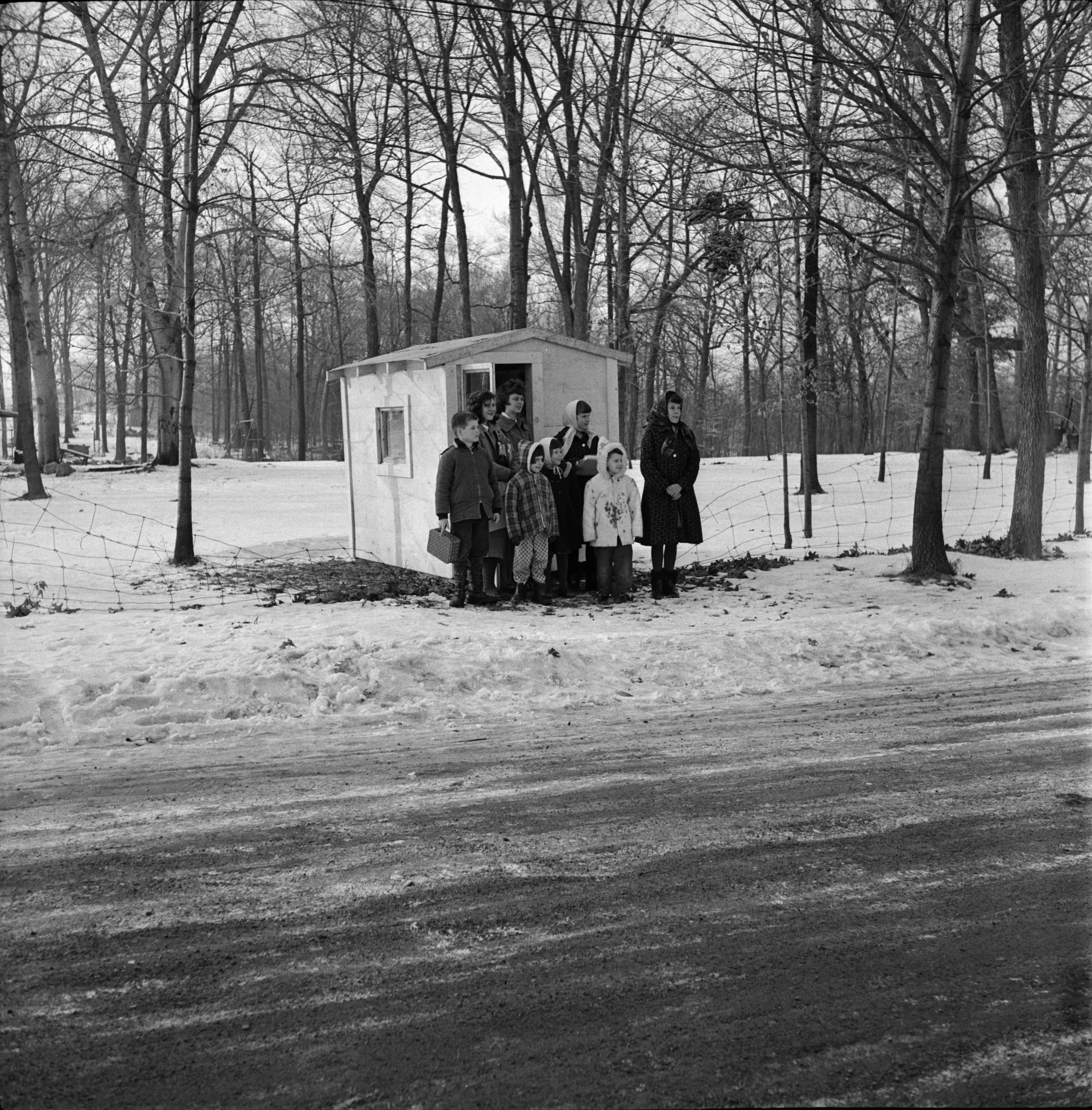Children Pose in Front of Shelter on Waters Road, January 1963 image