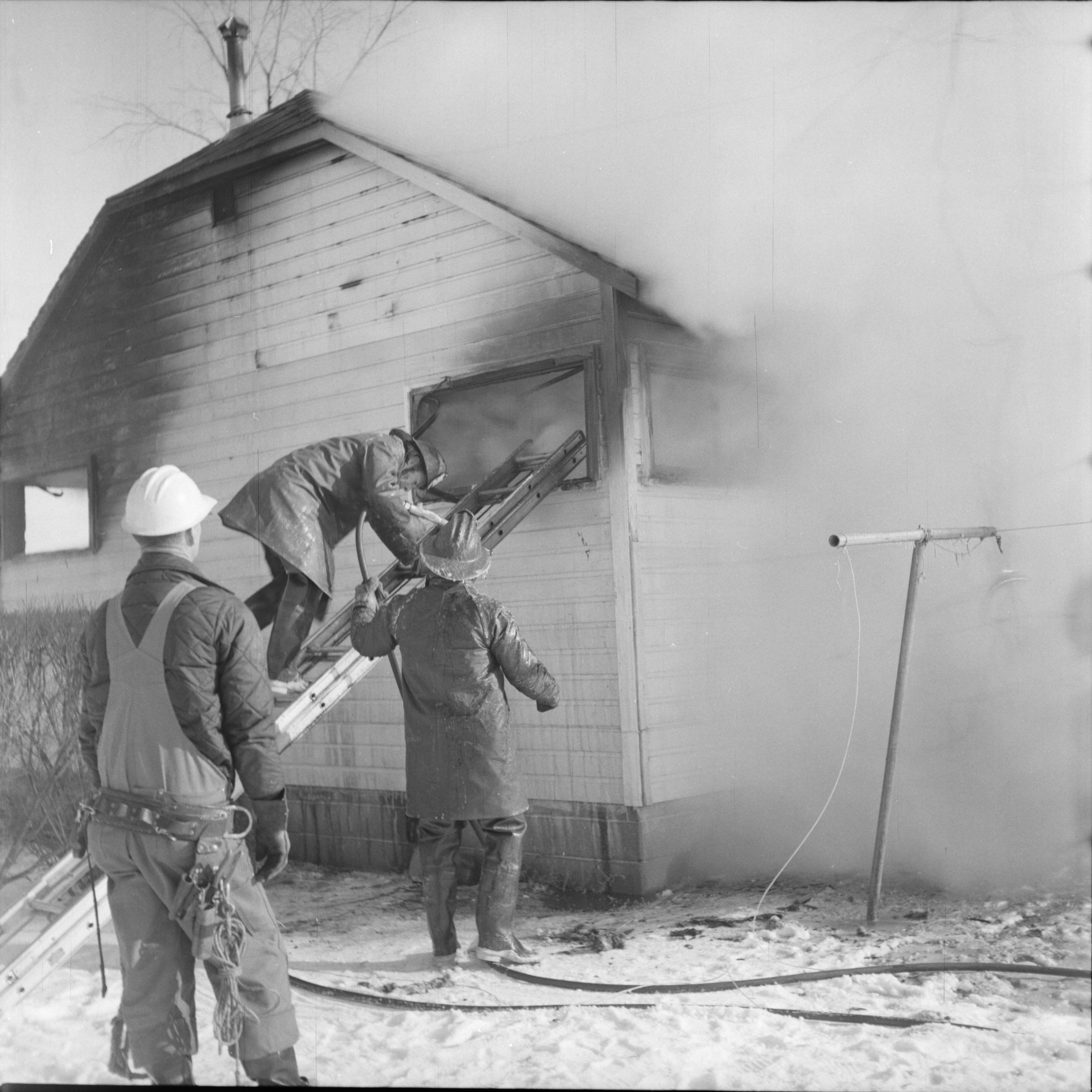 Firemen at Burning Home on Ellsworth Rd, February 1965 image
