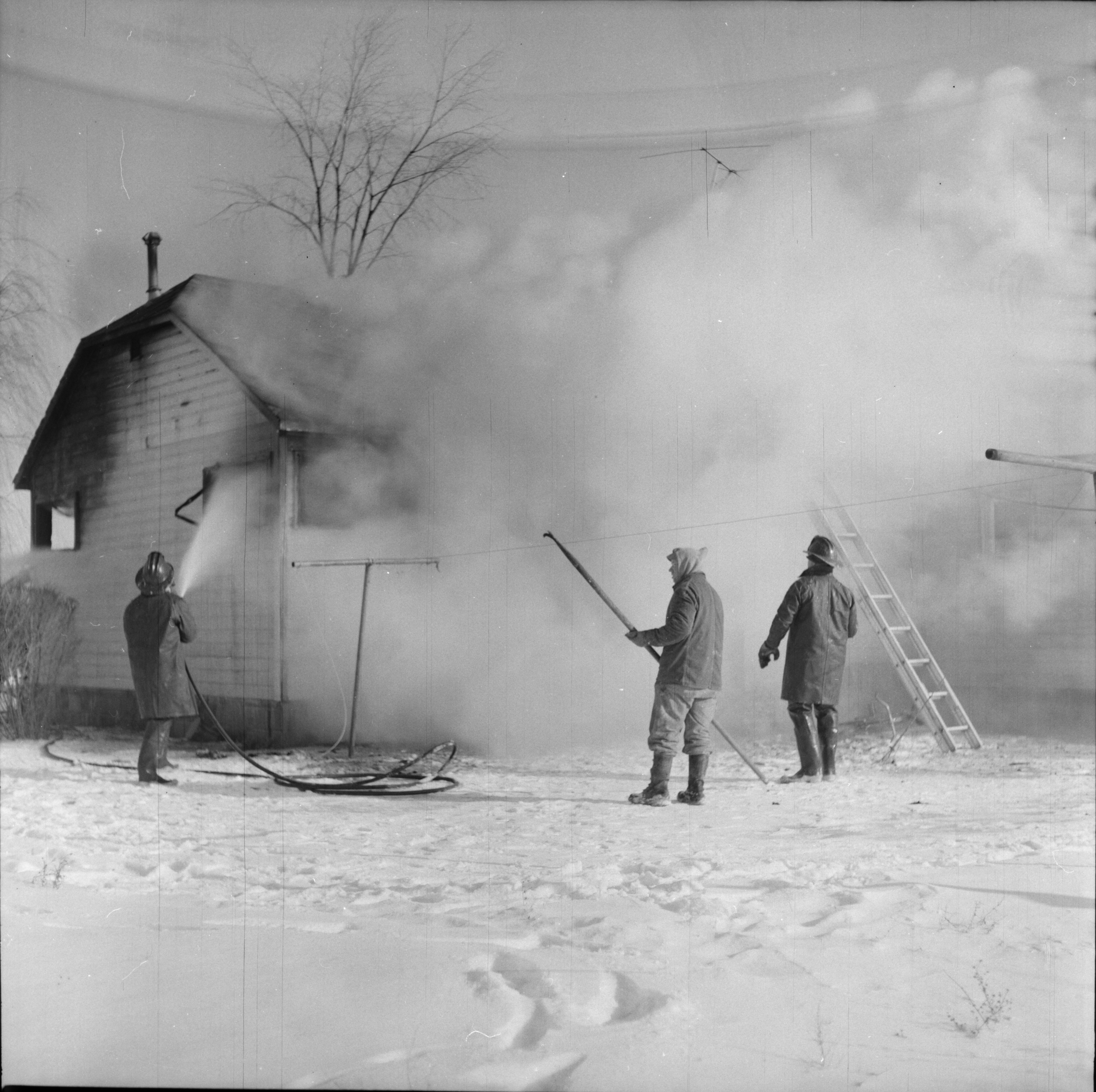 Firemen Work to Put Out Fire at Home on Ellsworth Rd, February 1965 image